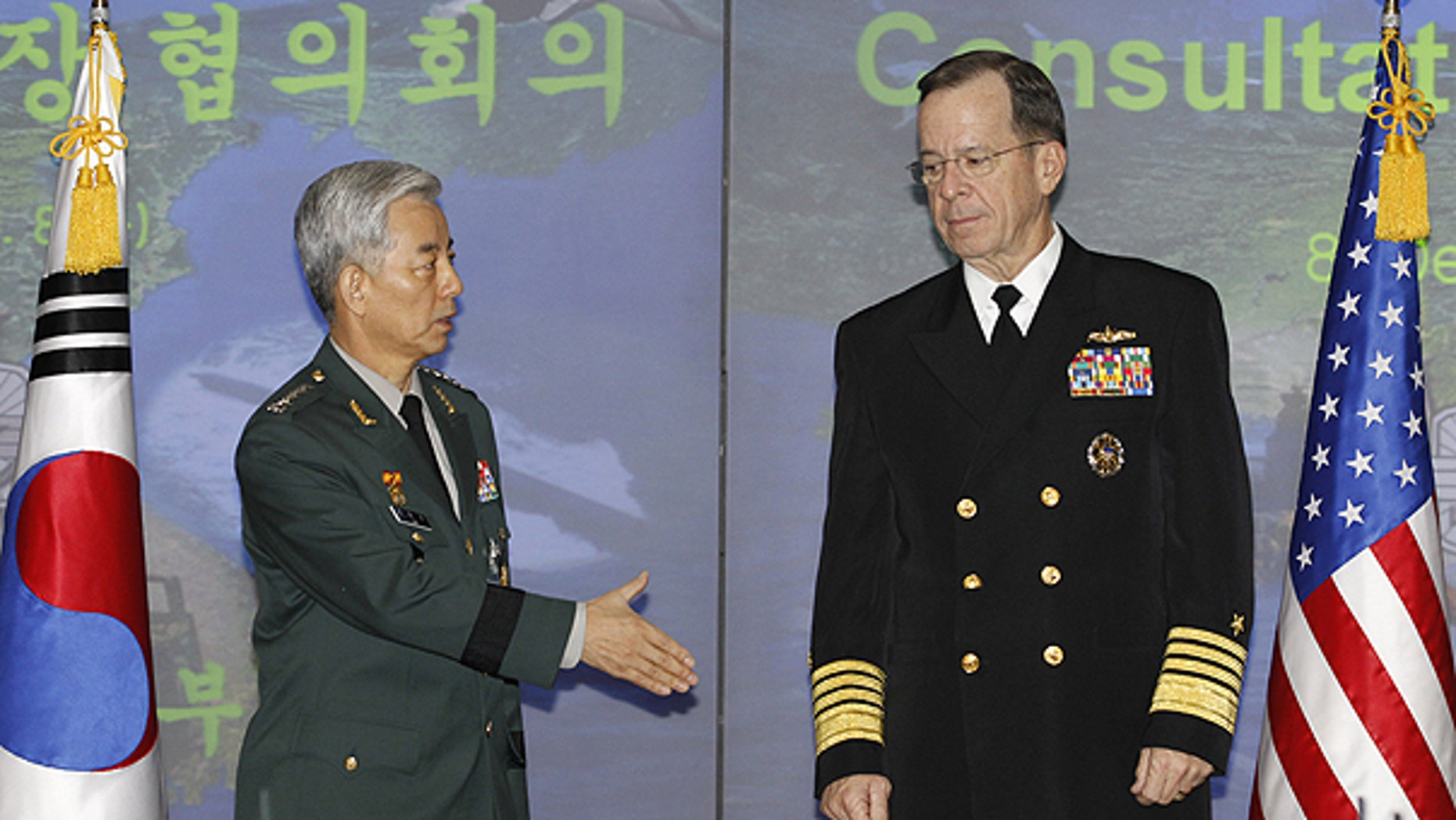 Dec. 8: Gen. Han Min-koo, chairman of South Korean Joint Chiefs of Staff, and his U.S. counterpart Adm. Mike Mullen pose for photographers before their talks at a headquarters of South Korean Defense Ministry in Seoul.