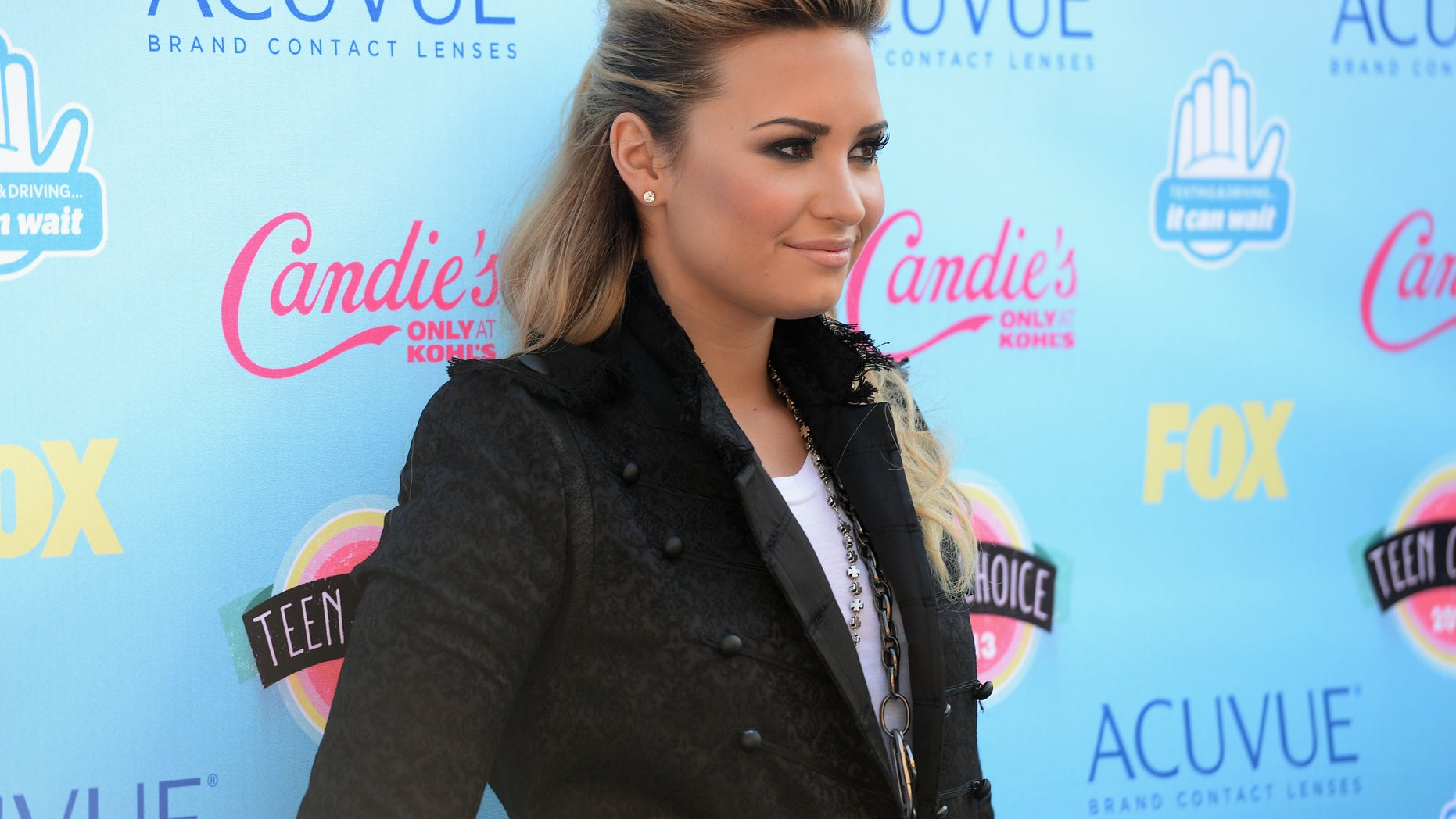 Singer Demi Lovato attends the Teen Choice Awards 2013 at Gibson Amphitheatre on August 11, 2013 in Universal City, California.