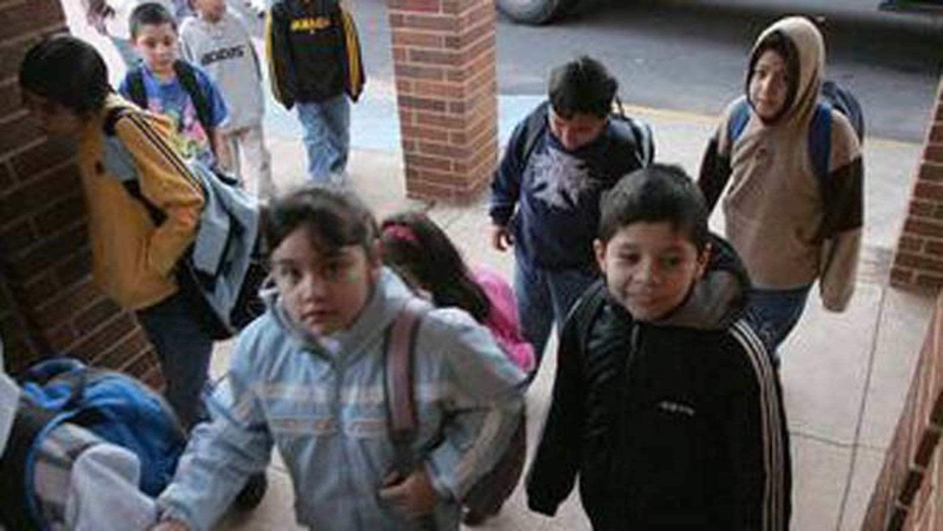 ** ADVANCE FOR WEEKEND OF MARCH 19-20 **Students make their from their buses to school at the Lyman Hall Elementary school in Gainesville, Ga., Wednesday, Feb. 23, 2005. Lyman Hall Elementary is listed as 94 percent Hispanic. (AP Photo/Ric Feld)