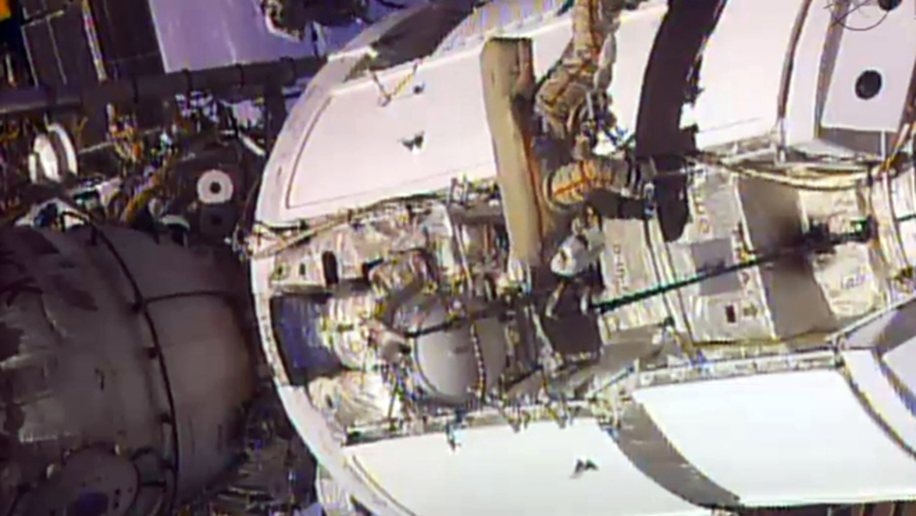 June 24, 2013: In this frame grab from video provided by NASA, two Russian flight engineers perform maintenance on the International Space Station.