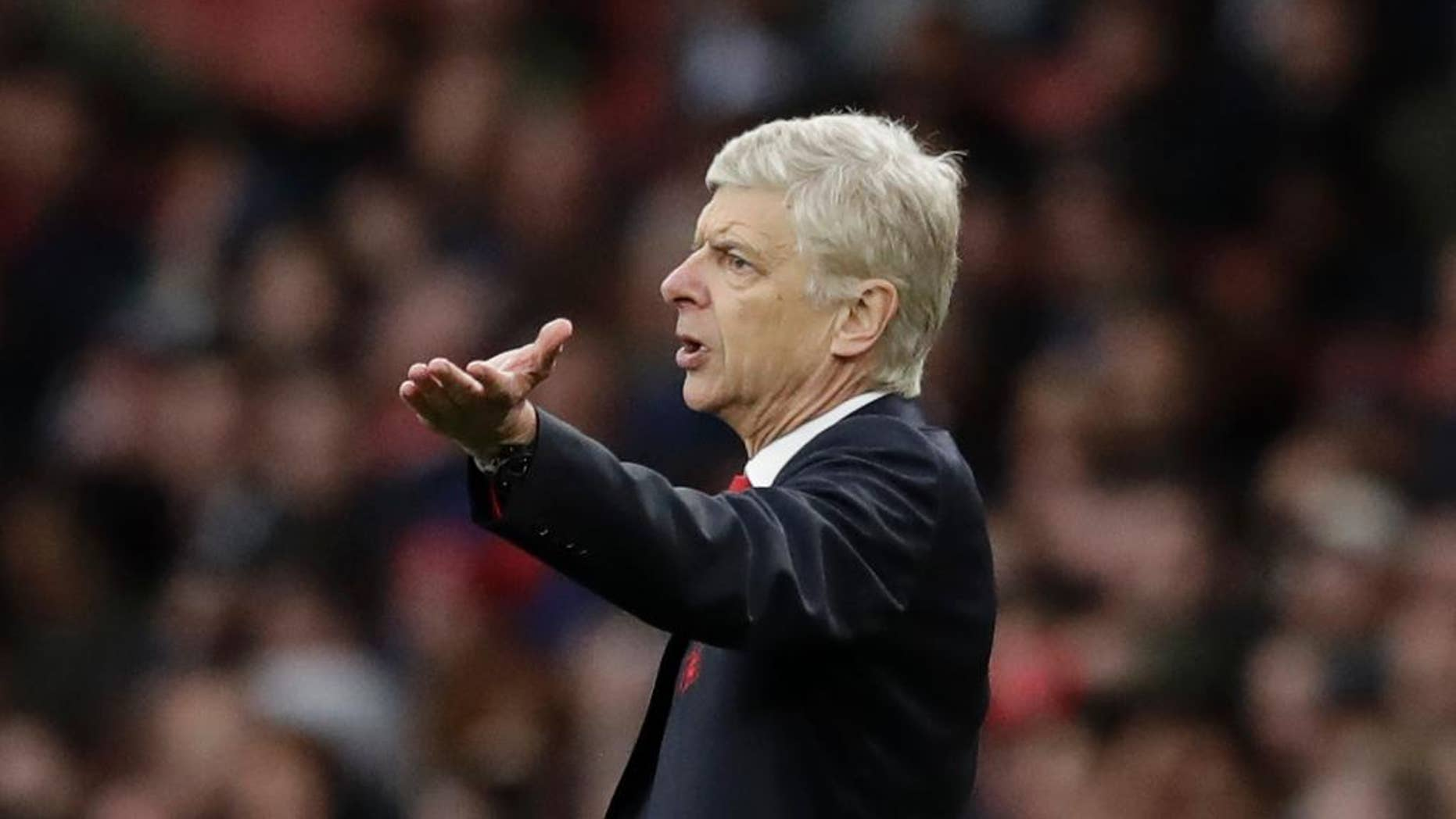 FILE  - In this Saturday, Oct. 22, 2016 file photo, Arsenal's manager Arsene Wenger gestures during the English Premier League soccer match between Arsenal and Middlesbrough at the Emirates Stadium in London. The English Football Association has banned Arsenal manager Arsene Wenger from the touchline for four matches after an altercation with a match official. Wenger escaped a stadium ban for shoving fourth official Anthony Taylor in the tunnel area at Emirates Stadium on Sunday, Jan. 22, 2017 during Arsenal's 2-1 victory over Burnley in the Premier League. (AP Photo/Matt Dunham)