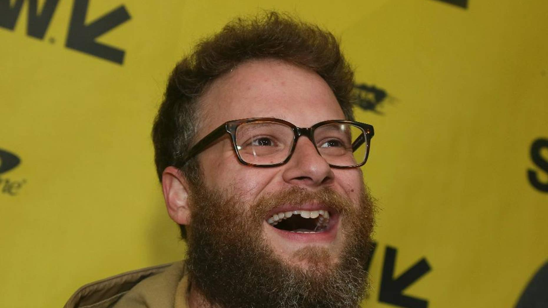 """FILE - In this March 12, 2017, file photo, Seth Rogen arrives for """"The Disaster Artist"""" at the Paramount Theatre during the South by Southwest Film Festival in Austin, Texas. Rogen became an honorary member of the Pi Kappa Alpha fraternity chapter at the University of Vermont on April 17, 2017. (Photo by Jack Plunkett/Invision/AP, File)"""