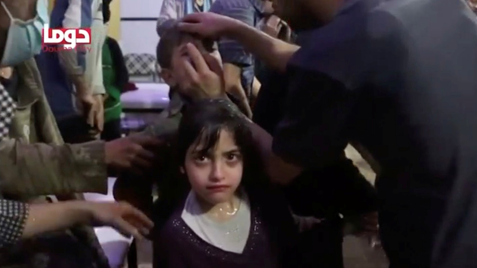 April 8: A girl looks on following alleged chemical weapons attack, in what is said to be Douma, Syria
