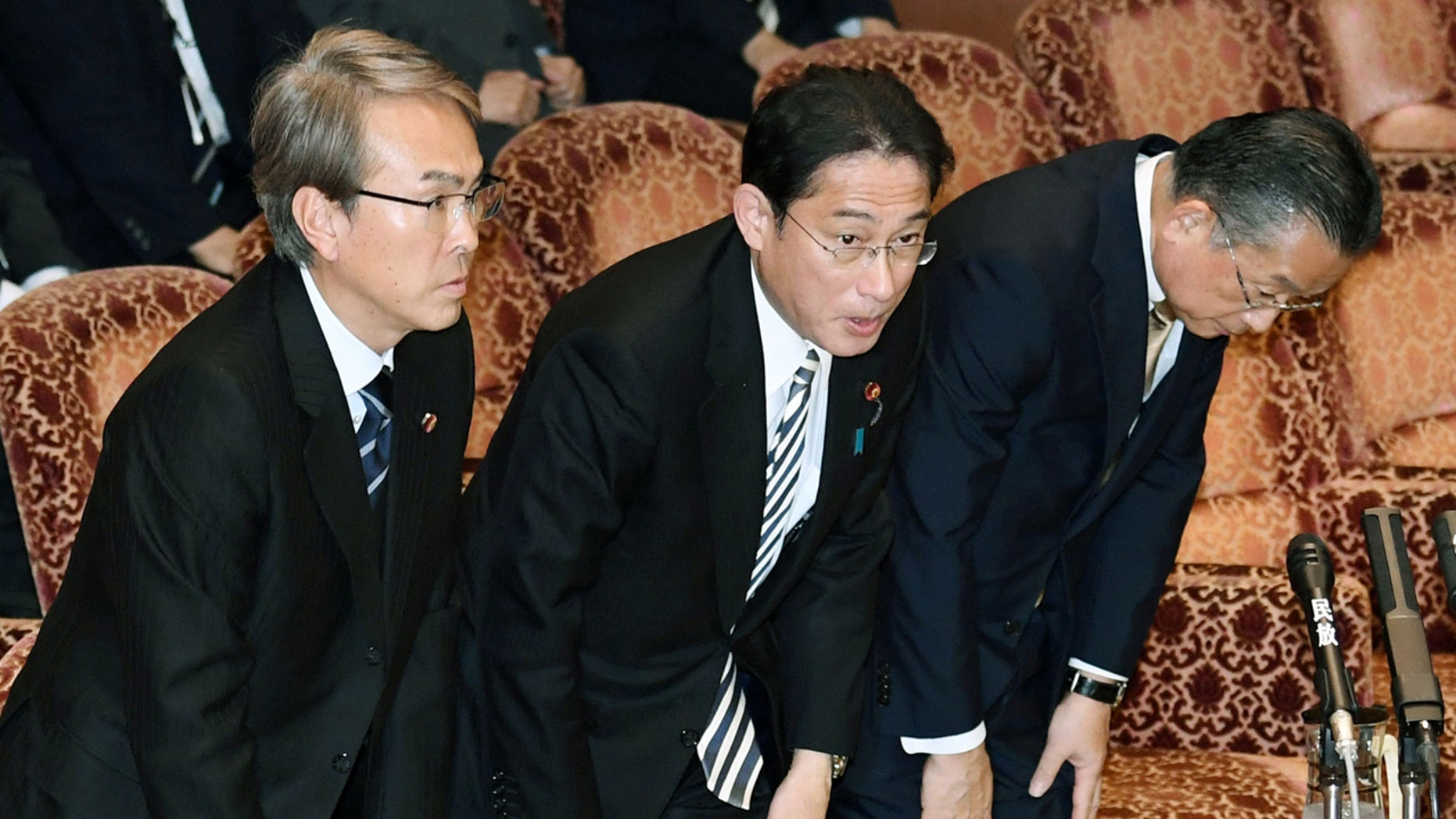Japanese Economic Revitalization Minister Nobuteru Ishihara, Foreign Minister Fumio Kishida and Agriculture Minister Yuji Yamamoto, from left, bow after the Trans-Pacific Partnership (TPP) was approved during a special committee at the parliament's upper house in Tokyo Friday, Dec. 9, 2016.