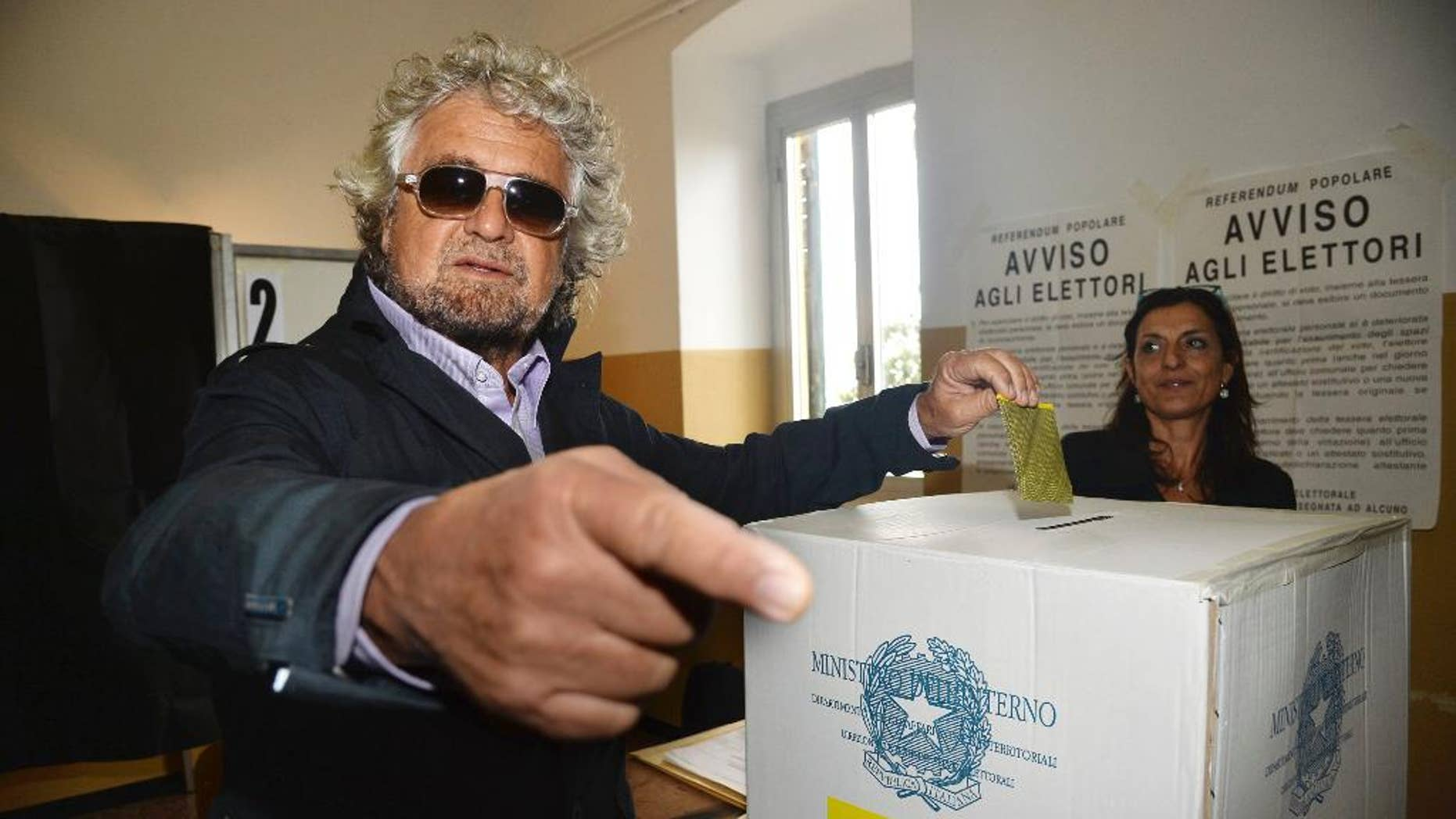 Co-founder of 5-Star Movement Beppe Grillo casts his ballot for a referendum on the duration of offshore drilling concessions, in Rome, Sunday, April 17, 2016. Italians are voting in a referendum on the duration of offshore drilling concessions in territorial waters, as nine regional governments seek to wrestle some influence over energy policy away from the central government in Rome. (Luca Zennaro/ANSA via AP)