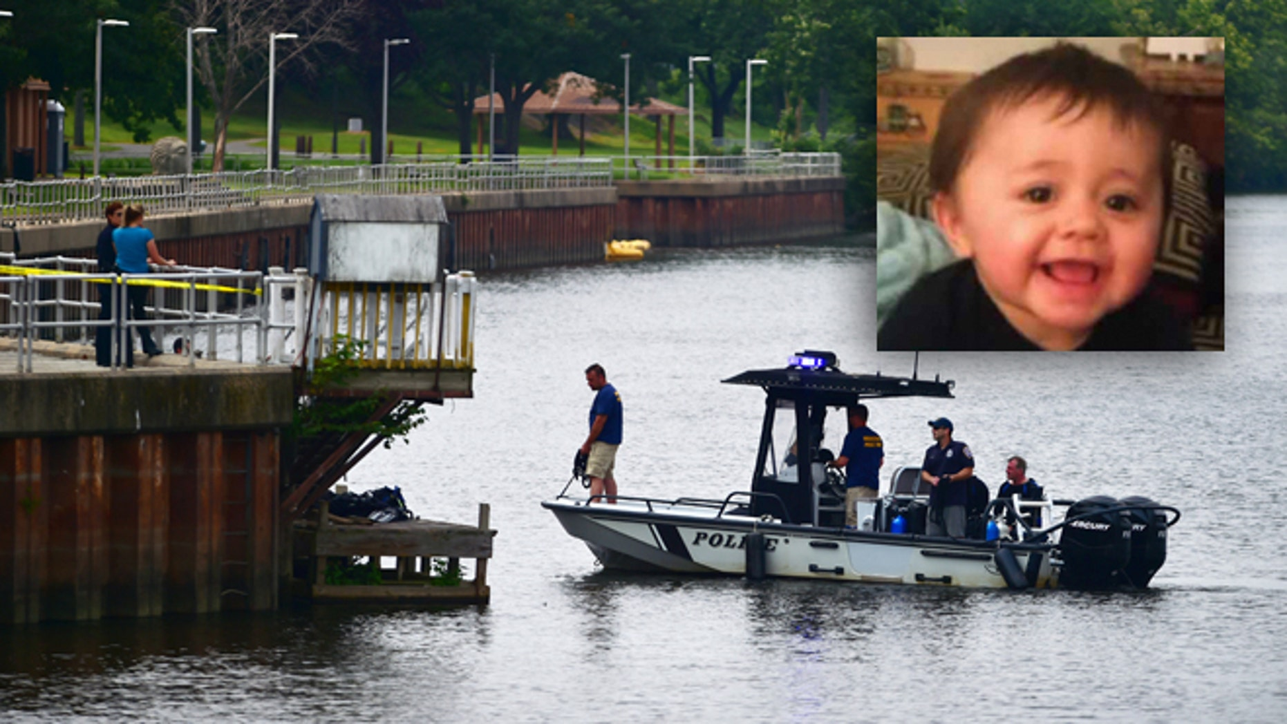Authorities continue a search of the Connecticut River for a missing child, Monday, July 6, 2015, in Middletown, Conn. Police issued an alert Monday for 7-month-old Aaden Moreno, who may have been with his father when the man jumped from the Arrigoni Bridge Sunday night. (Catherine Avalone/The New Haven Register via AP) MANDATORY CREDIT