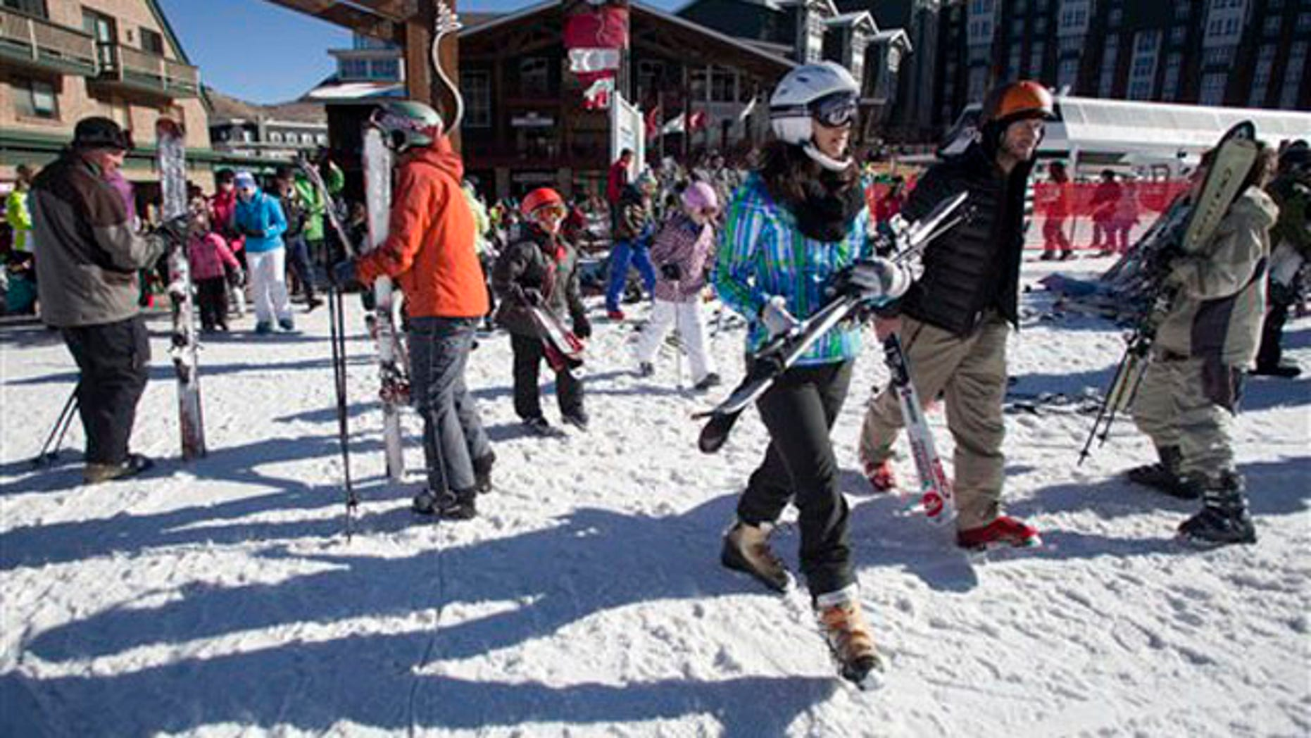 Skiers make their way to the slopes at Park City Mountain Resort in Park City, Utah, Saturday, Jan. 14, 2012.