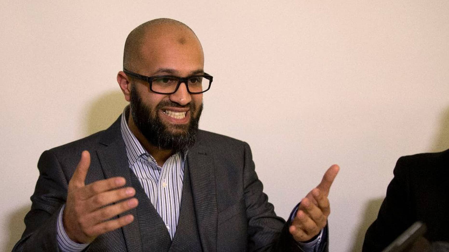 CAGE research director, Asim Qureshi talks during a press conference held by the CAGE human rights charity in London, Thursday, Feb. 26, 2015. A British-accented militant who has appeared in beheading videos released by the Islamic State group in Syria bears ìstriking similaritiesî to a man who grew up in London, a Muslim lobbying group said Thursday. Mohammed Emwazi has been identified by news organizations as the masked militant more commonly known as ìJihadi John.î London-based CAGE, which works with Muslims in conflict with British intelligence services, said Thursday its research director, Asim Qureshi, saw strong similarities, but because of the hood worn by the militant, ìthere was no way he could be 100 percent certain.î (AP Photo/Matt Dunham)