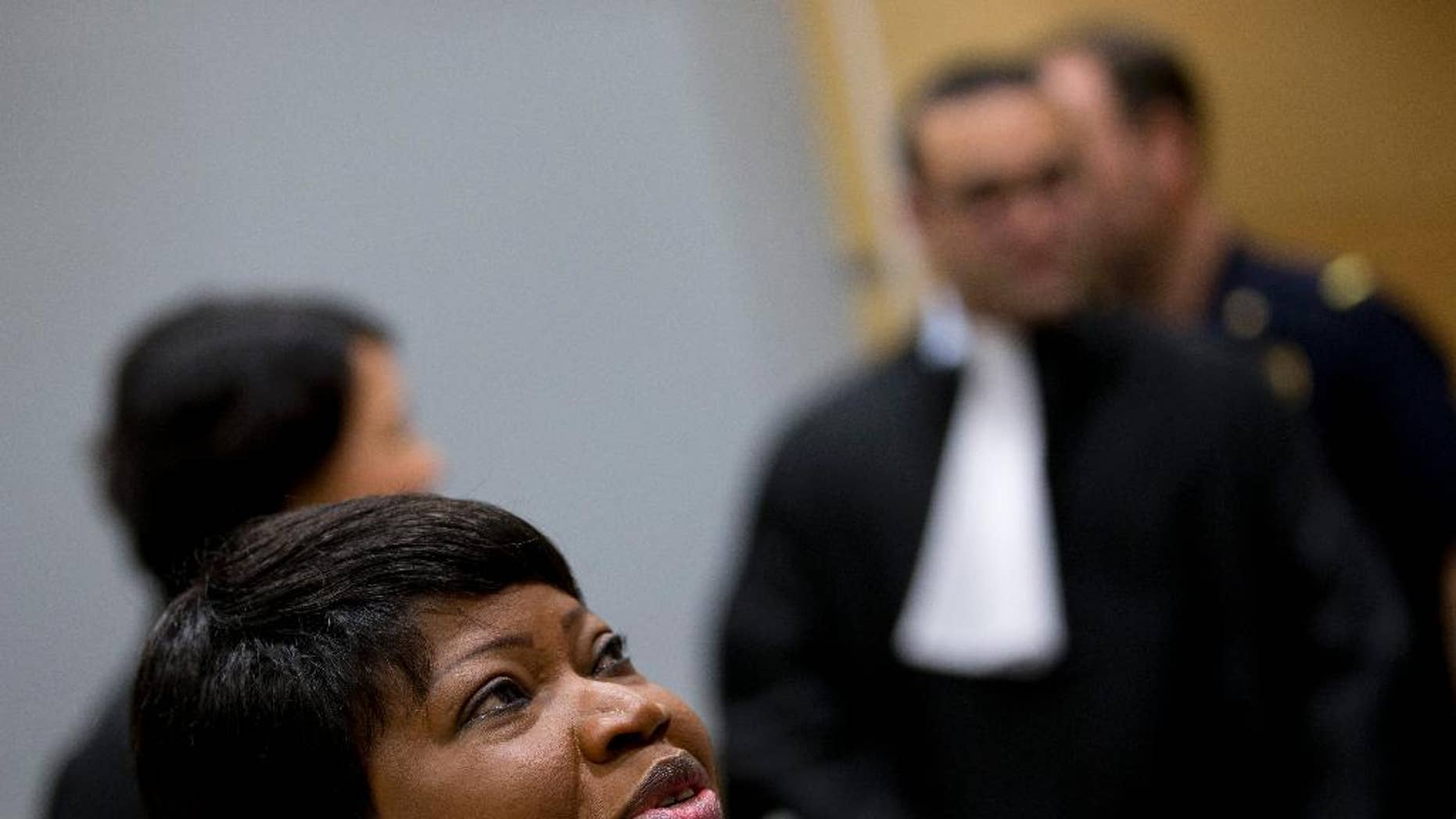 Prosecutor Fatou Bensouda of Gambia looks up as she waits for the start of the proceedings against Dominic Ongwen, a Ugandan commander in warlord Joseph Kony's feared militia, made his first appearance before judges at the International Criminal Court in The Hague, Netherlands, Monday, Jan. 26, 2015. Ongwen arrived in The Hague last week after being taken into custody in Central African Republic. He faces war crimes and crimes against humanity charges for his alleged role in a reign of terror that has spanned more than 25 years in central Africa's Great Lakes region. (AP Photo/Peter Dejong, Pool)