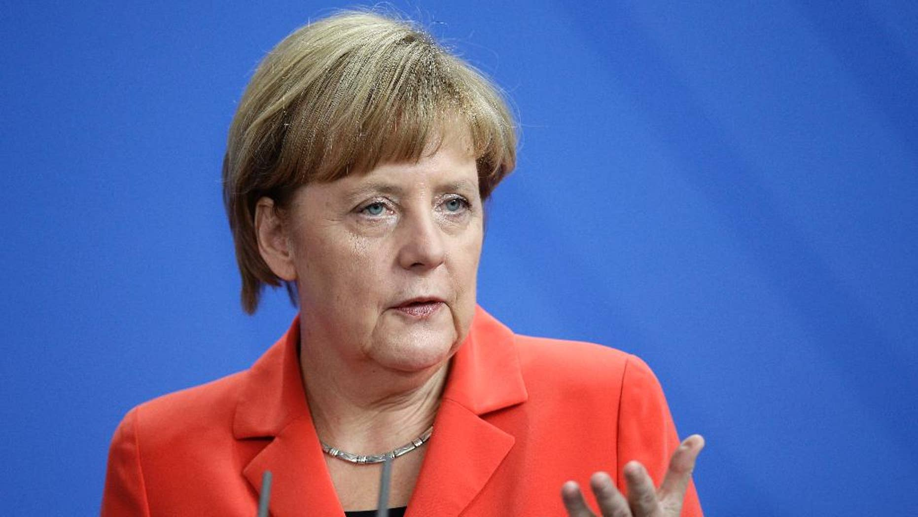 German Chancellor Angela Merkel addresses the media during a joint news conference with Prime Minister of France Manuel Valls, as part of a meeting at the chancellery in Berlin, Germany, Monday, Sept. 22, 2014. (AP Photo/Michael Sohn)