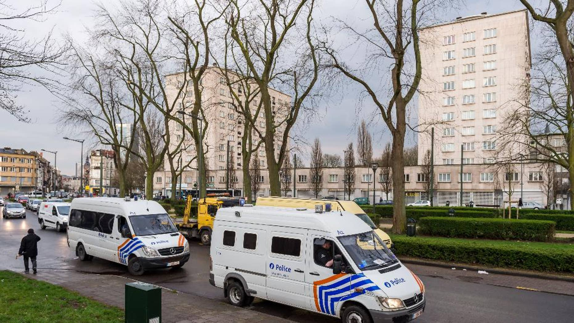 """Police secure an area where two terror suspects were arrested in Brussels on Friday April 8, 2016. A fugitive suspect in the Nov. 13 Paris attacks was arrested in Belgium on Friday, French police officials said, after a raid Belgian authorities said was linked to the deadly March 22 Brussels bombings. The suspect, Mohamed Abrini, is believed to be the mysterious """"man in the hat"""" who escaped the double bombing at the Zaventem airport, according to one of the French officials.(AP Photo/Geert Vanden Wijngaert)"""