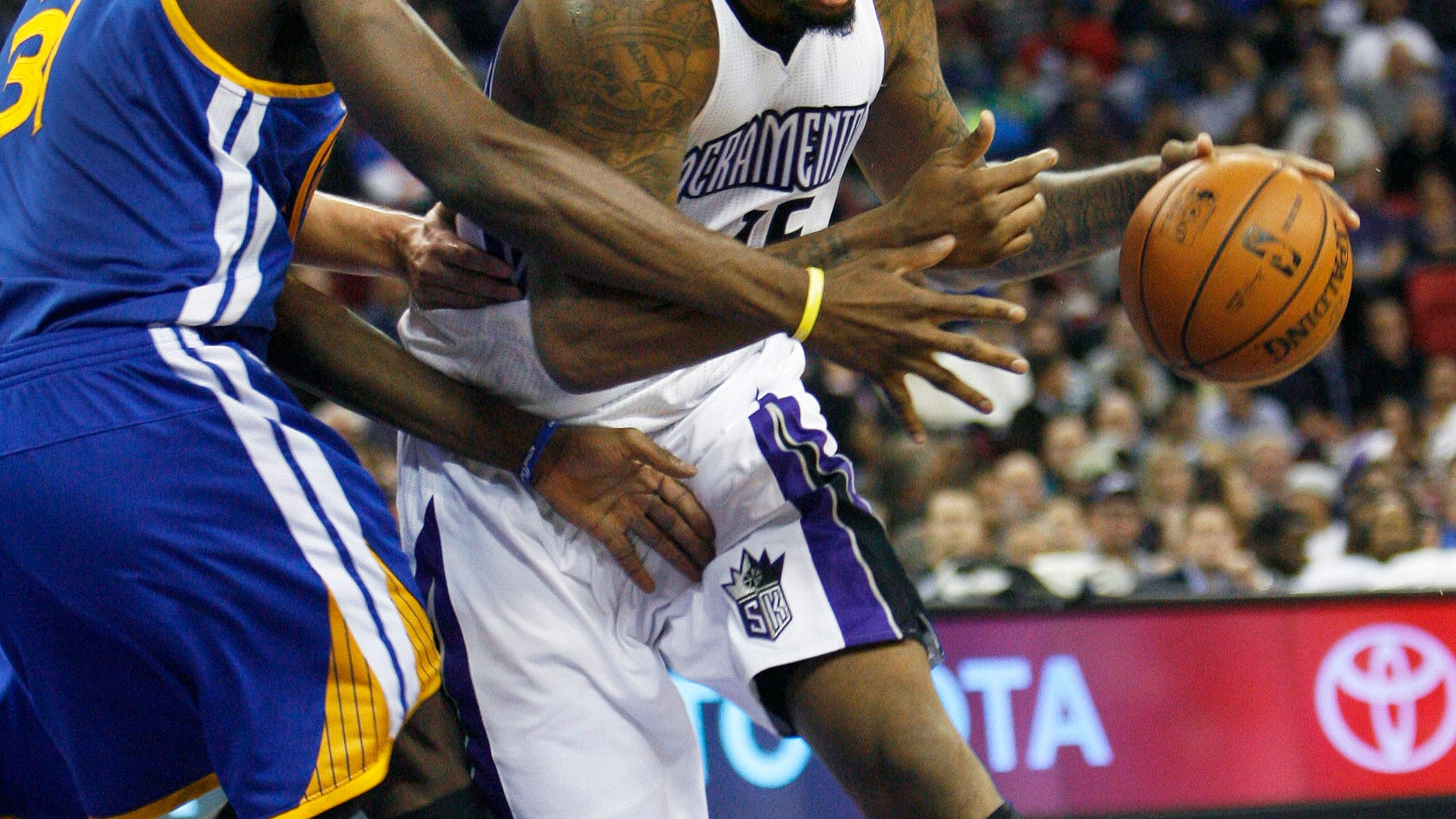Sacramento Kings center DeMarcus Cousins, right, drives to the basket around Golden State Warriors defender Festus Ezeli during the second half of an NBA basketball game in Sacramento, Calif., on Wednesday, Dec. 19, 2012. The Kings won 131-127.(AP Photo/Steve Yeater)