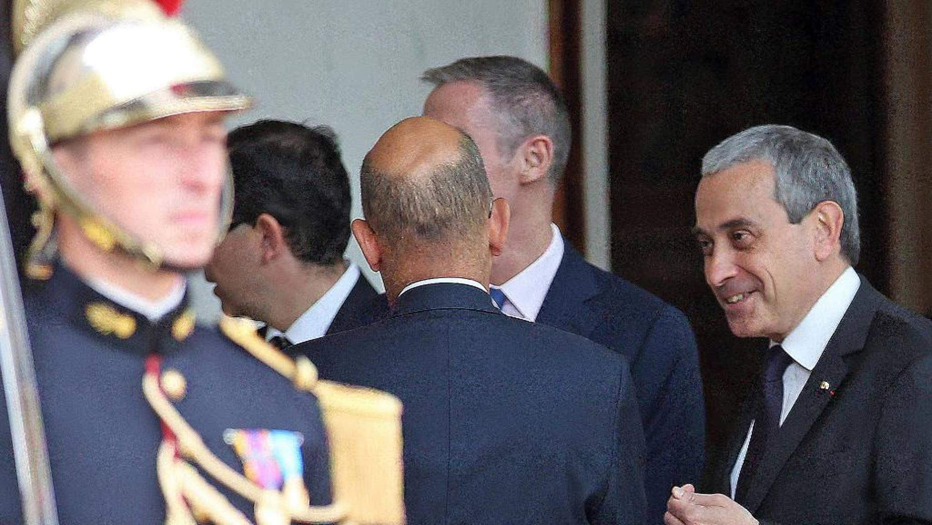 FILE - In this June 2, 2015 file photo chief of protocol at the French presidential palace, Laurent Stefanini, right, speaks with an unidentified person at the Elysee Palace in Paris. France's government has named a respected diplomat who is said to be gay as the country's ambassador to UNESCO, several months after he was nominated as ambassador to the Vatican _ a job he never started. (AP Photo/Remy de la Mauviniere, File)