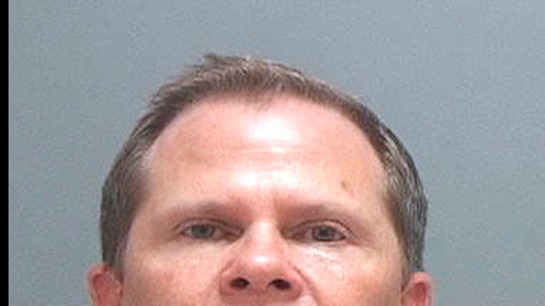 This undated photo released Wednesday, Oct. 30, 2013, by the Salt Lake County Sheriff shows Michael Pascal, 45, of Park City, Utah, who is charged in a criminal complaint from the U.S. Attorney's Office in Utah with abusive sexual contact. Pascal, an airline pilot riding as a passenger on Oct. 26, is facing federal charges after being accused of groping a 14-year-old girl while he was a passenger on a flight from Detroit to Salt Lake City. (AP Photo/Salt Lake County Sheriff)