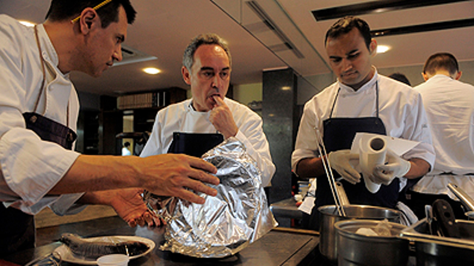 This March 30, 2011 photo shows Spanish chef Ferran Adria as he tastes some food in the kitchen of his restaurant elBulli in Roses, Spain. The oft-imitated, modernist wizardry that Adria has pioneered for nearly 20 years in Spain's far northeastern tip has earned him fame, awards and the highest of honors.    (AP Photo/Manu Fernandez)