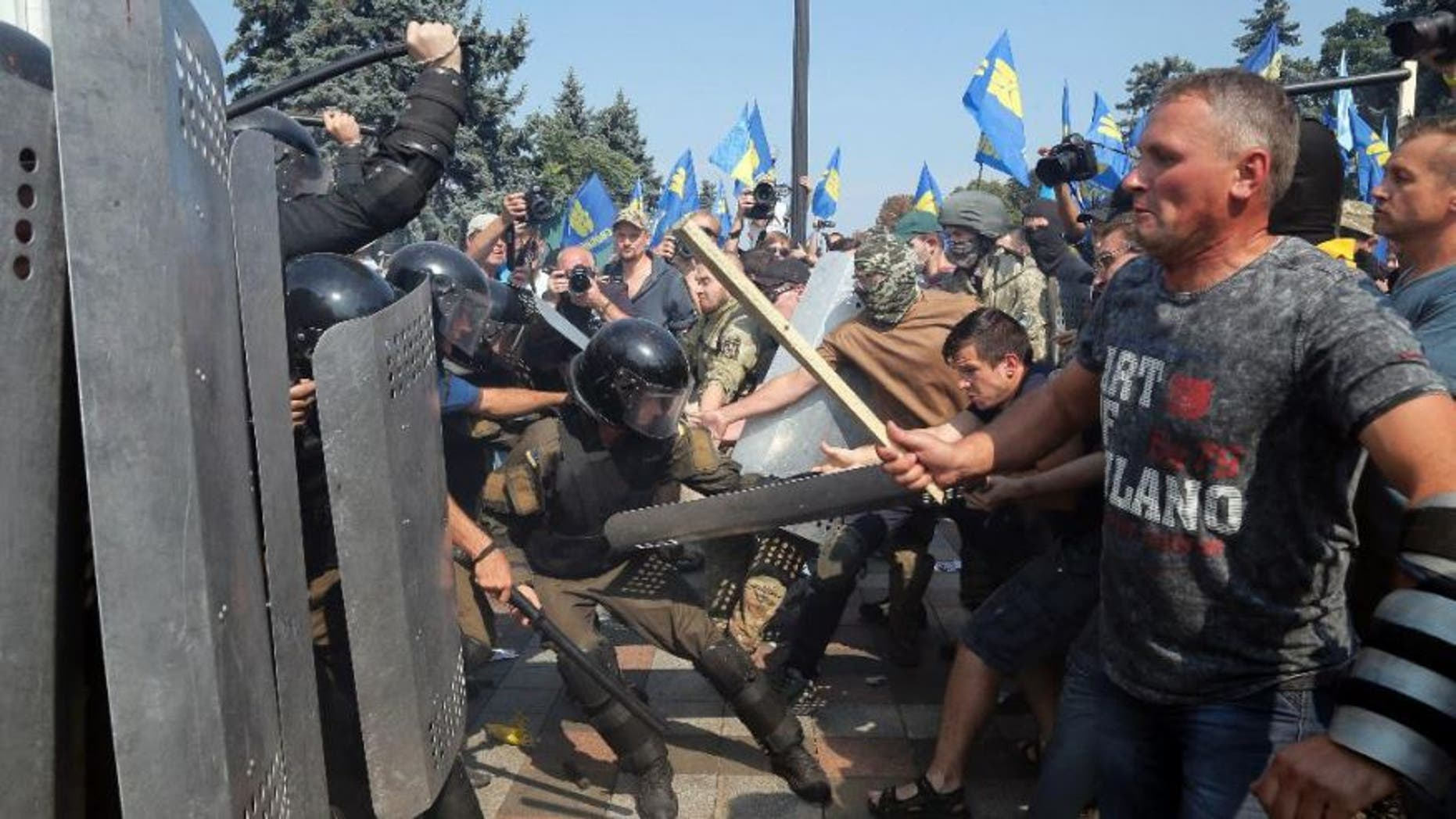 August 31, 2015: Ukraine protesters clash with police in Kiev after vote to give greater powers to the east.