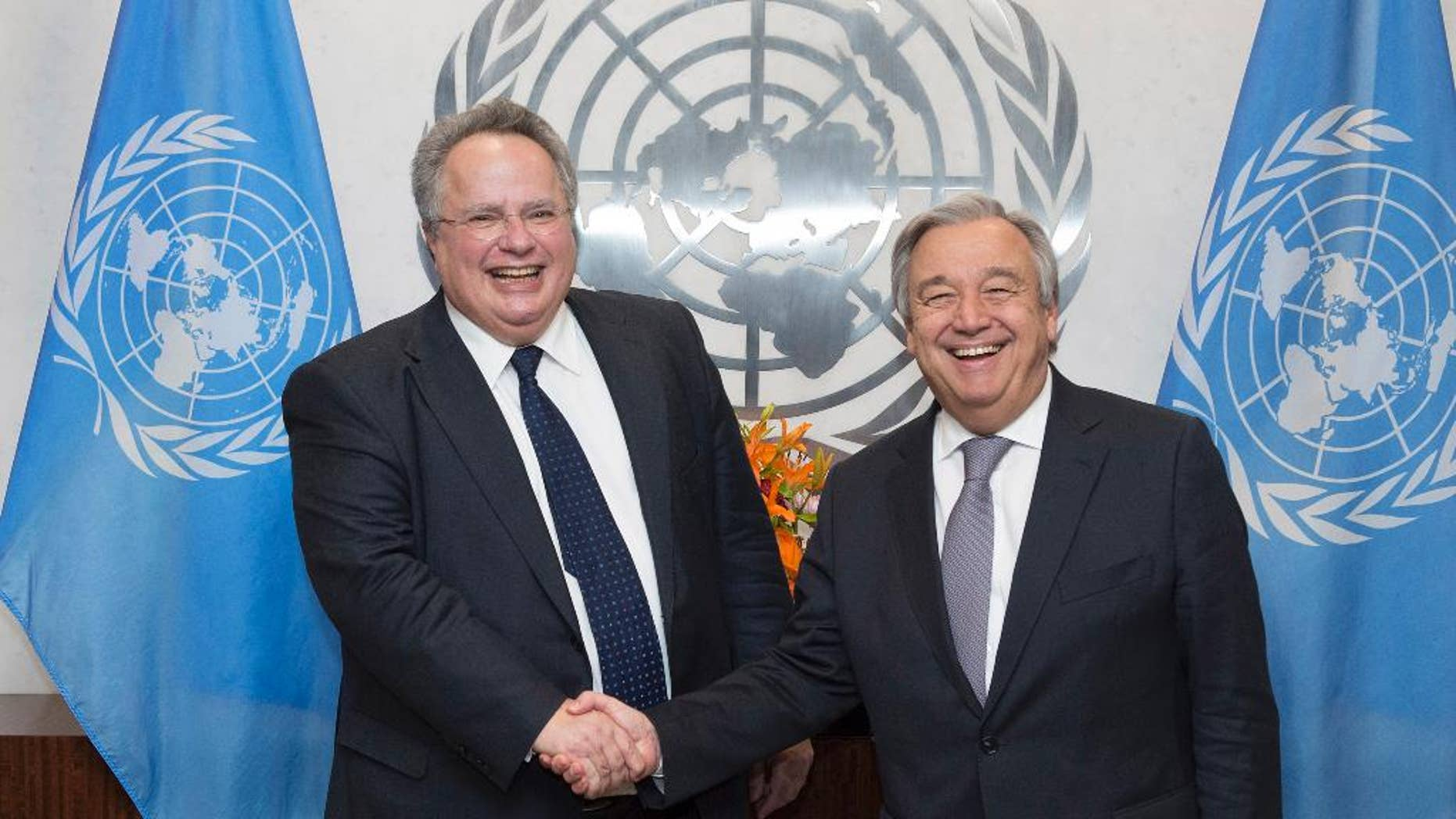 In this photo provided by the United Nations, U.N. Secretary-General Antonio Guterres, right, shakes hands with Greek Foreign Minister Nikos Kotzias at U.N. headquarters, Friday, Jan. 6, 2017. (Eskinder Debebe/The United Nations via AP)