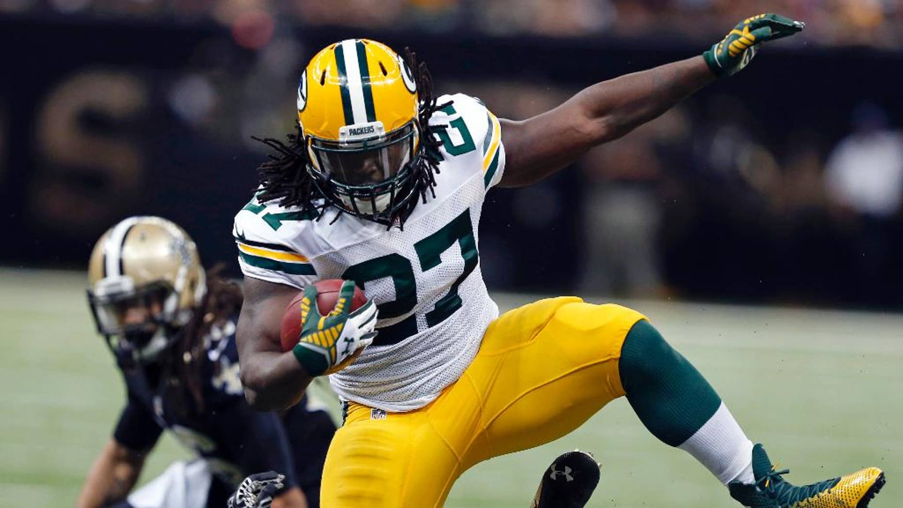 FILE - In this Oct. 26, 2014, file photo, Green Bay Packers running back Eddie Lacy (27) carries over fallen New Orleans Saints free safety Rafael Bush (25) in the second half of an NFL football game in New Orleans. Lacy is rolling over defenders. Aaron Rodgers is rolling in general. The Packers have climbed into a first-place tie in the NFC North by winning six of their last seven games. (AP Photo/Rogelio Solis, File)