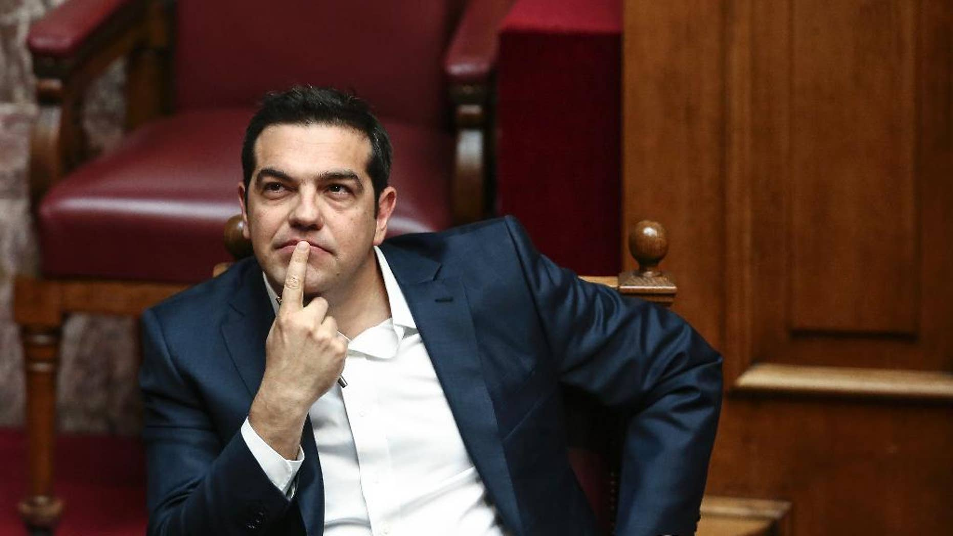 Greece's Prime Minister Alexis Tsipras attends a parliamentary session in Athens, Sunday, May 22, 2016.  Greek parliament votes on a bill ahead of a Eurogroup meeting next week which is likely to unlock bailout funds for the country. (AP Photo/ Yorgos Karahalis )