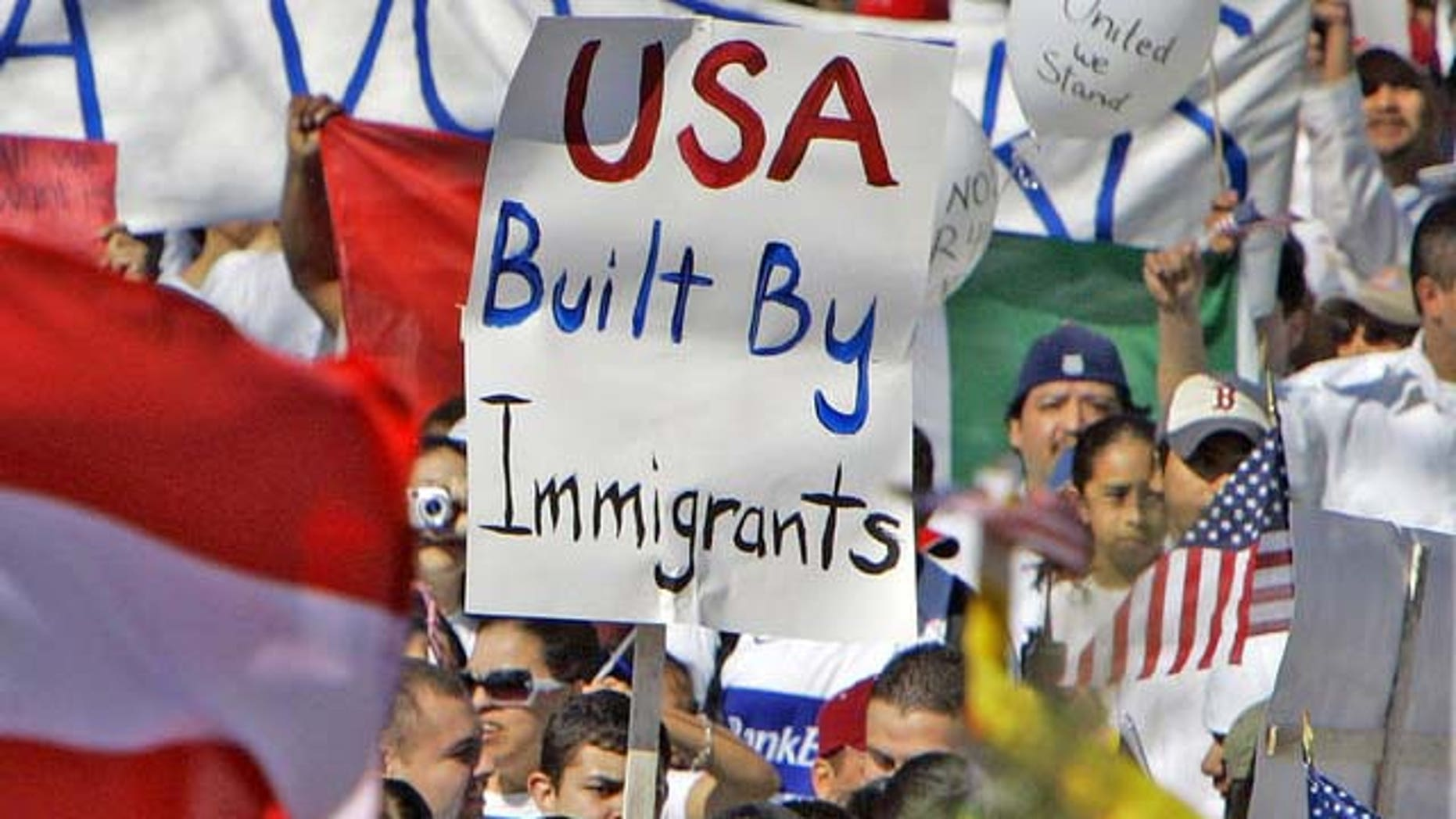 """Some 4,000 people attend a rally outside the Capitol in Lincoln, Neb., Monday, April 10, 2006, where protesters carried flags from the United States, Mexico and other nations. Thousands of immigrants gathered at rallies across the state Monday as part of a national day of action billed as a """"campaign for immigrants' dignity."""" (AP Photo/Nati Harnik)"""