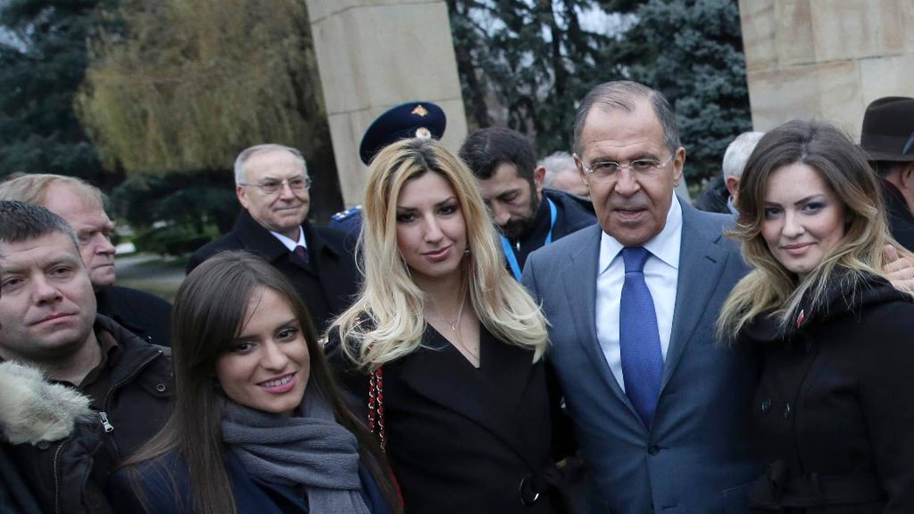 FILE - In this Monday Dec. 12, 2016 file photo, Russian Foreign Minister Sergey Lavrov, second right, poses for photos with members of a far-right pro-Russian group of which Nemanja Ristic, first left, is a member. A Serbian court on Thursday Feb. 9, 2017, has rejected an extradition request by Montenegro for Nemanja Ristic suspected of taking part in an alleged pro-Russian plot to overthrow the small Balkan country's government. (AP Photo, File)