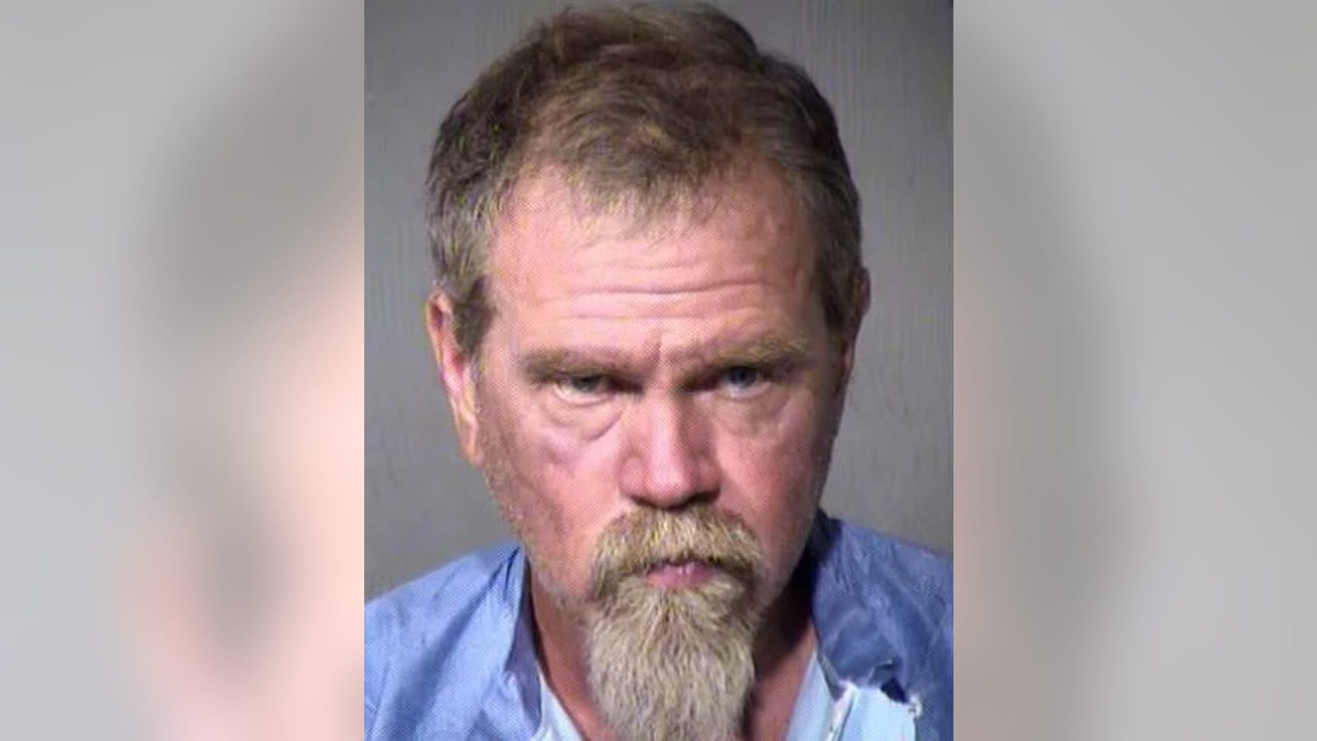 Matthew David Hall, 52, has been charged after authorities claimed he moved a deceased man's body and put his head in a bucket for preservation.