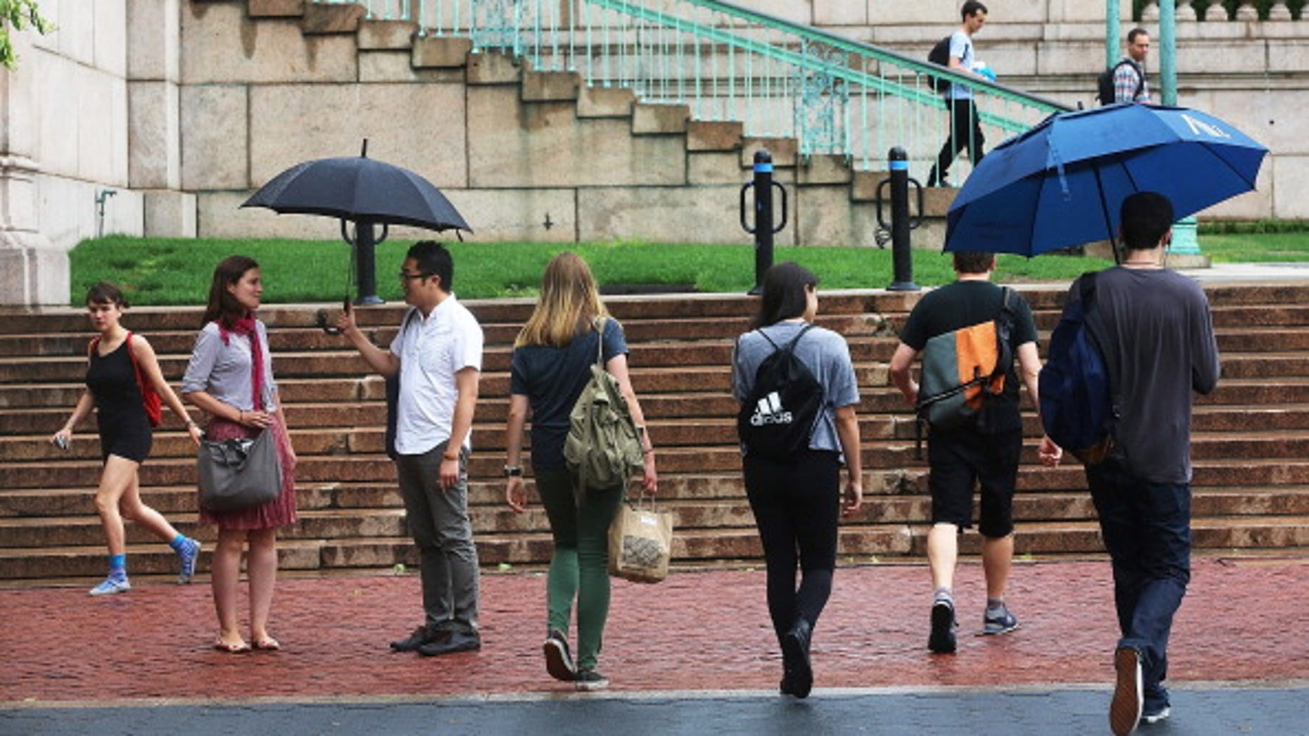 NEW YORK, NY - JULY 01:  People walk on the Columbia University campus on July 1, 2013 in New York City. An interest rate hike kicks in today for student loans, an increase for 7 million students. Congress left town at the end of last week failing to prevent rates on new Stafford student loans increasing from 3.4 percent to 6.8 percent.  (Photo by Mario Tama/Getty Images)