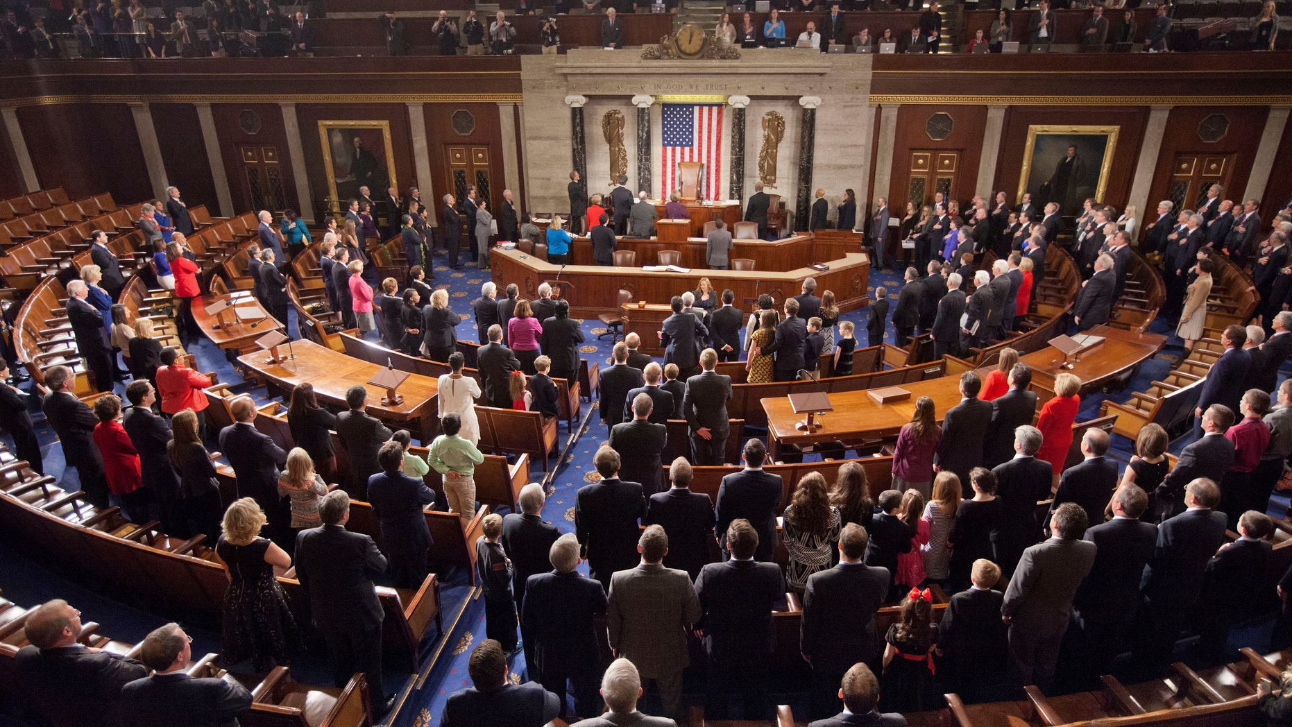 FILE --  Jan. 6, 2015: Members of the House of Representatives stand for the Pledge of Allegiance at the opening session of the 114th Congress, on Capitol Hill in Washington.