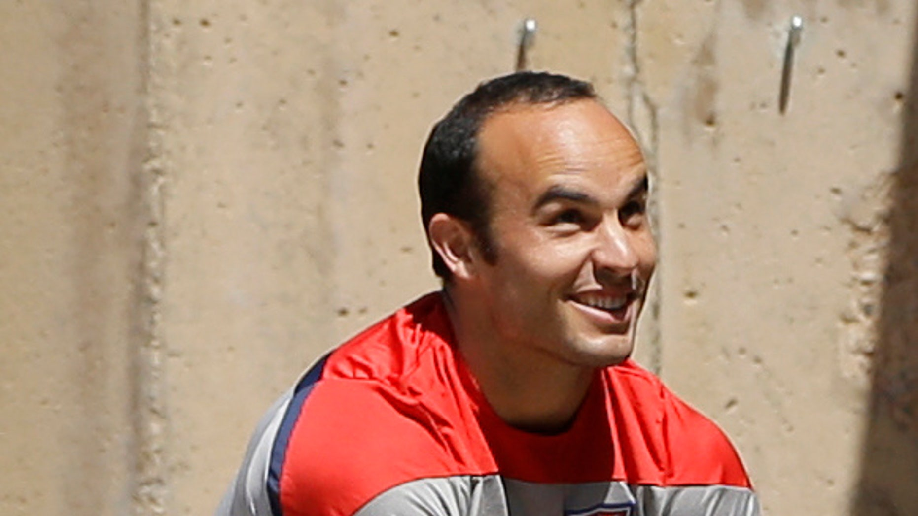 U.S. forward Landon Donovan stretches prior to practice for the World Cup soccer tournament Thursday, May 22, 2014, in Stanford, Calif. Donovan was cut from the roster later Thursday for the World Cup. (AP Photo/Ben Margot)