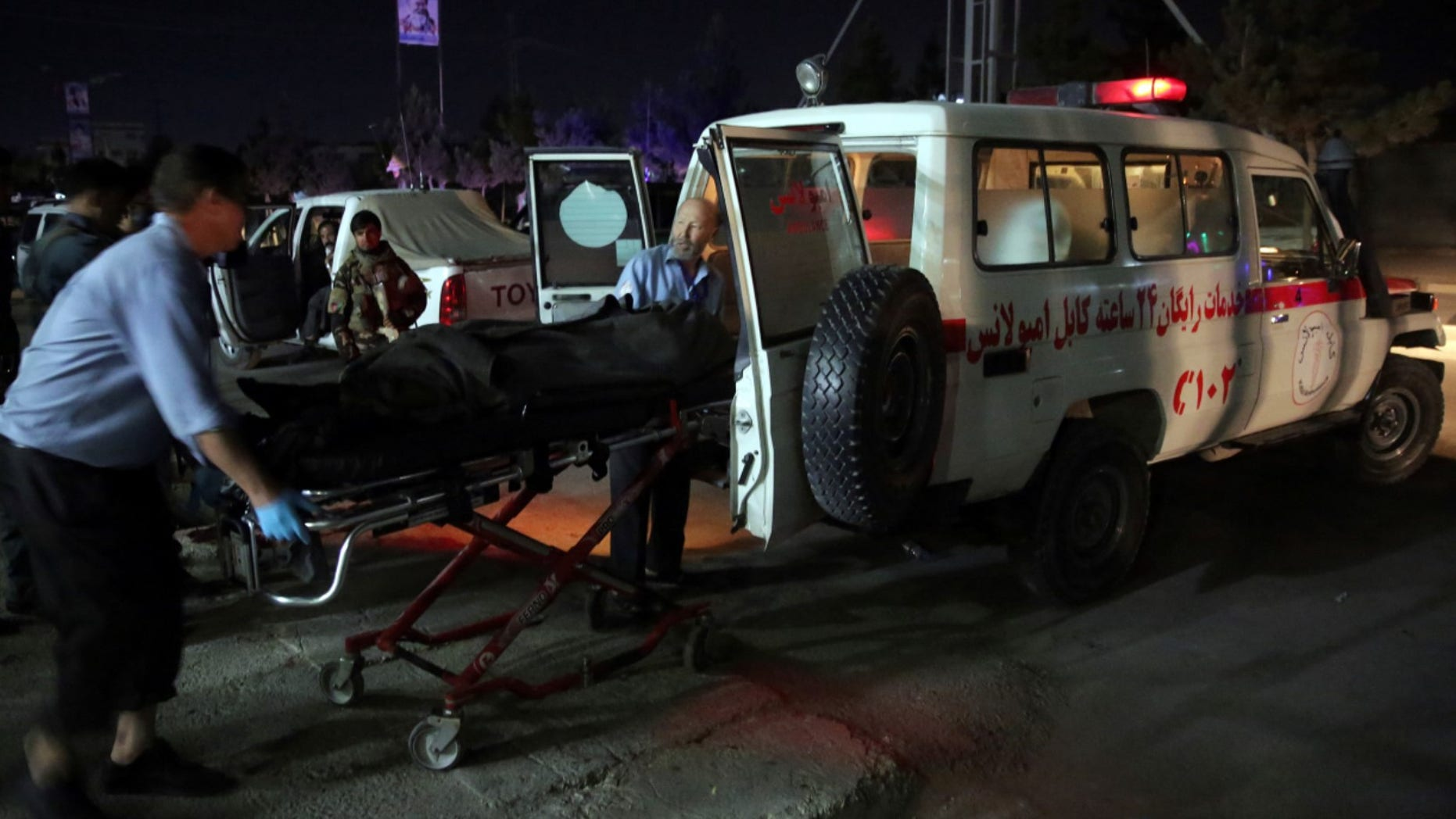 Medic personnel transport the body of a victim into an ambulance at the site of a suicide attack on a Shiites mosque in Kabul, Afghanistan, Thursday, June 15, 2017. A suicide bomber struck outside a Shiite mosque in the Afghan capital Kabul late Thursday night, killing a leader of Afghanistan's ethnic Hazaras, Hajji Ramazan Hussainzada, and others. (AP Photos/Massoud Hossaini)