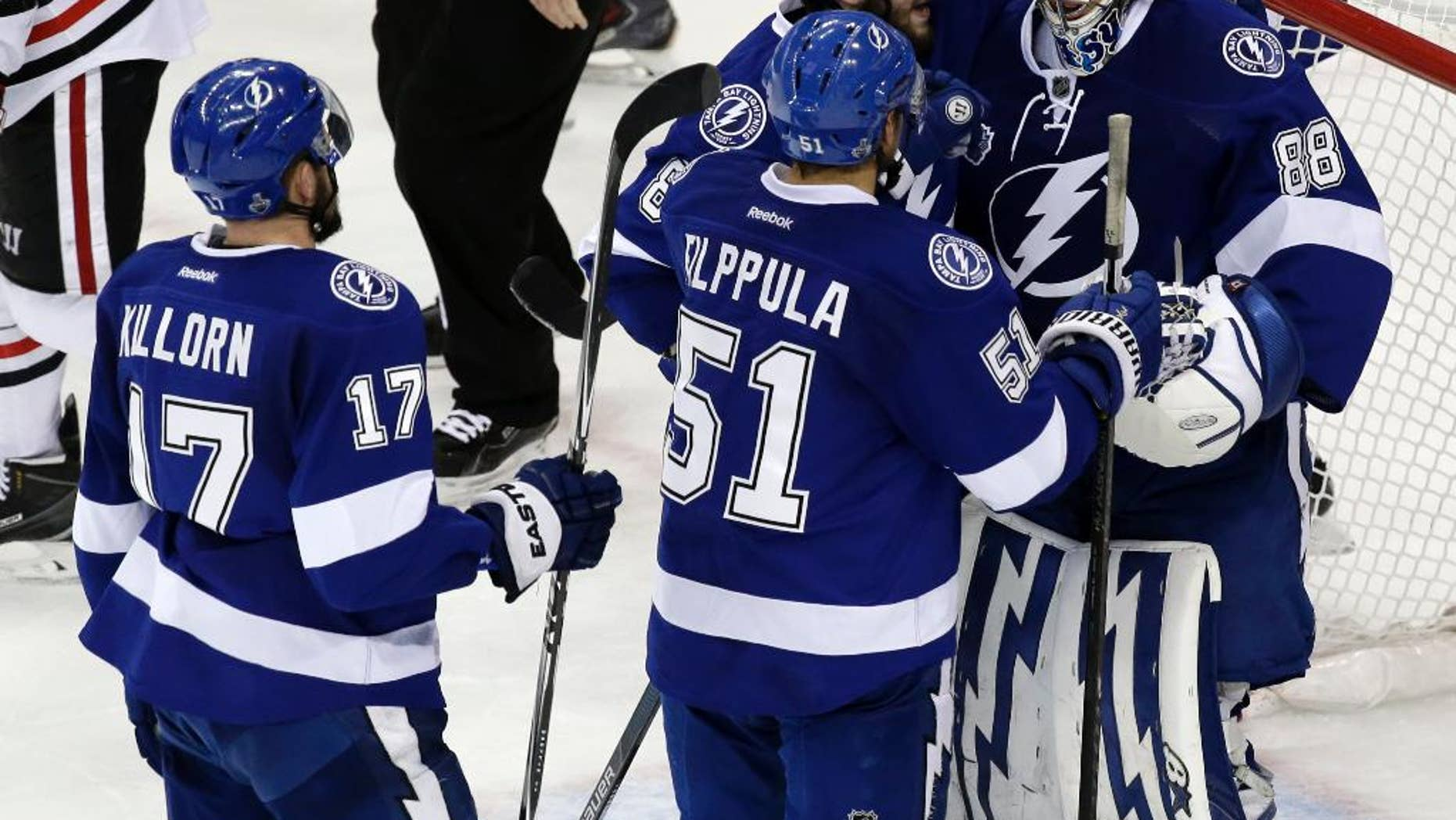 Tampa Bay Lightning players greet backup goalie Andrei Vasilevskiy after their win against the Chicago Blackhawks in Game 2 of the NHL hockey Stanley Cup Final on Saturday, June 6, 2015, in Tampa Fla. (AP Photo/John Raoux)