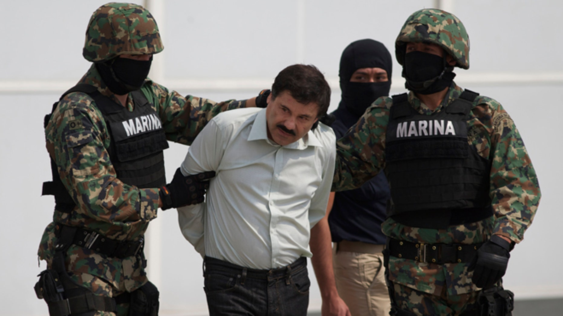 "Joaquin ""El Chapo"" Guzman is escorted to a helicopter in Mexico City, Saturday, Feb. 22, 2014."