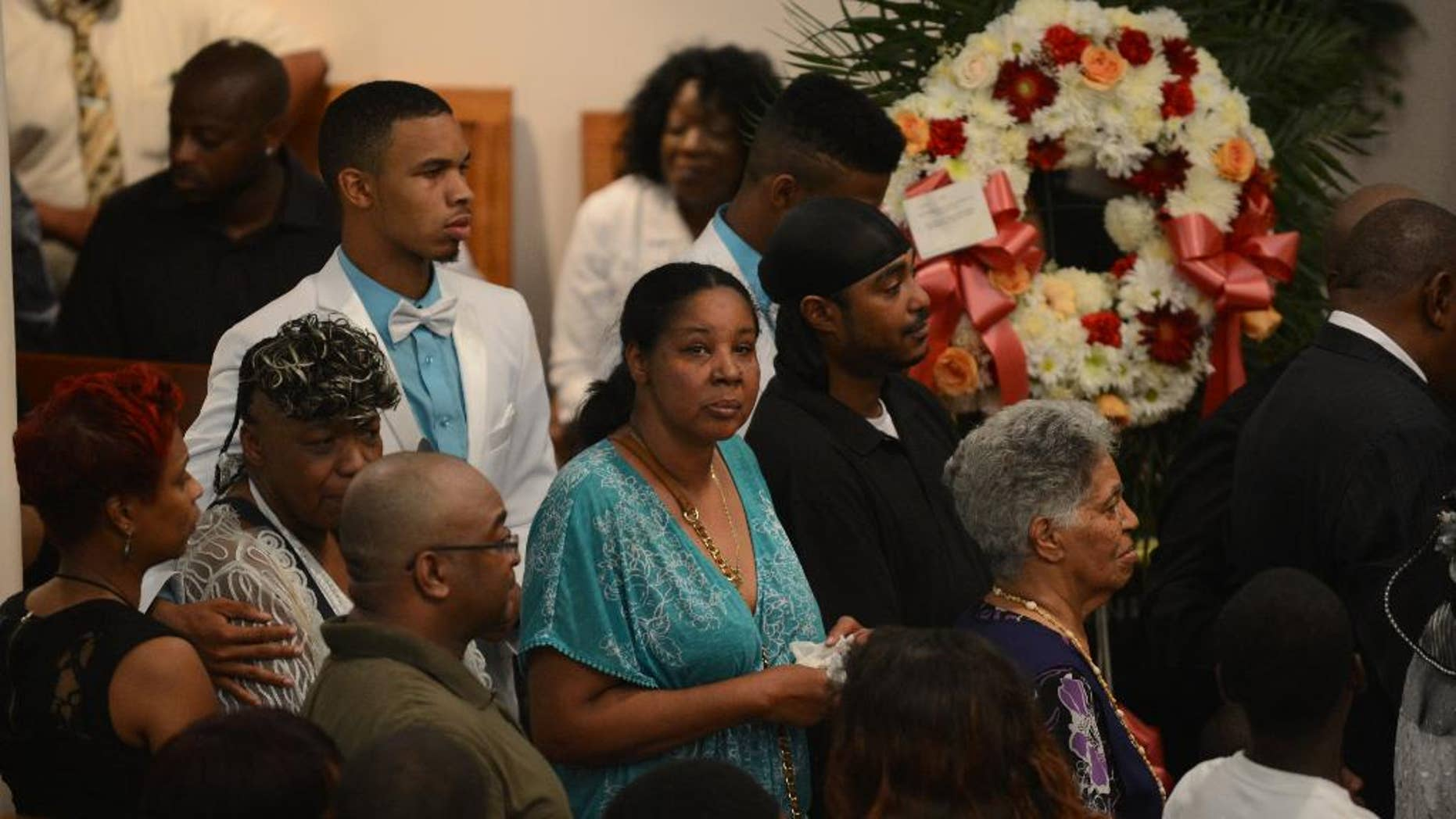 Esaw Garner, center, is followed by Gwendolyn Flagg-Carr, mother of Eric Garner, and Eric Snipes Garner, Jr., son of Eric Garner,  during funeral services for her Eric Garner, at Bethel Baptist Church in  the Brooklyn borough of New York Wednesday, July 23, 2014.  Garner's death while in police custody has led to accusations of police misconduct.  (AP Photo/The Daily News, Julia Xanathos, Pool)