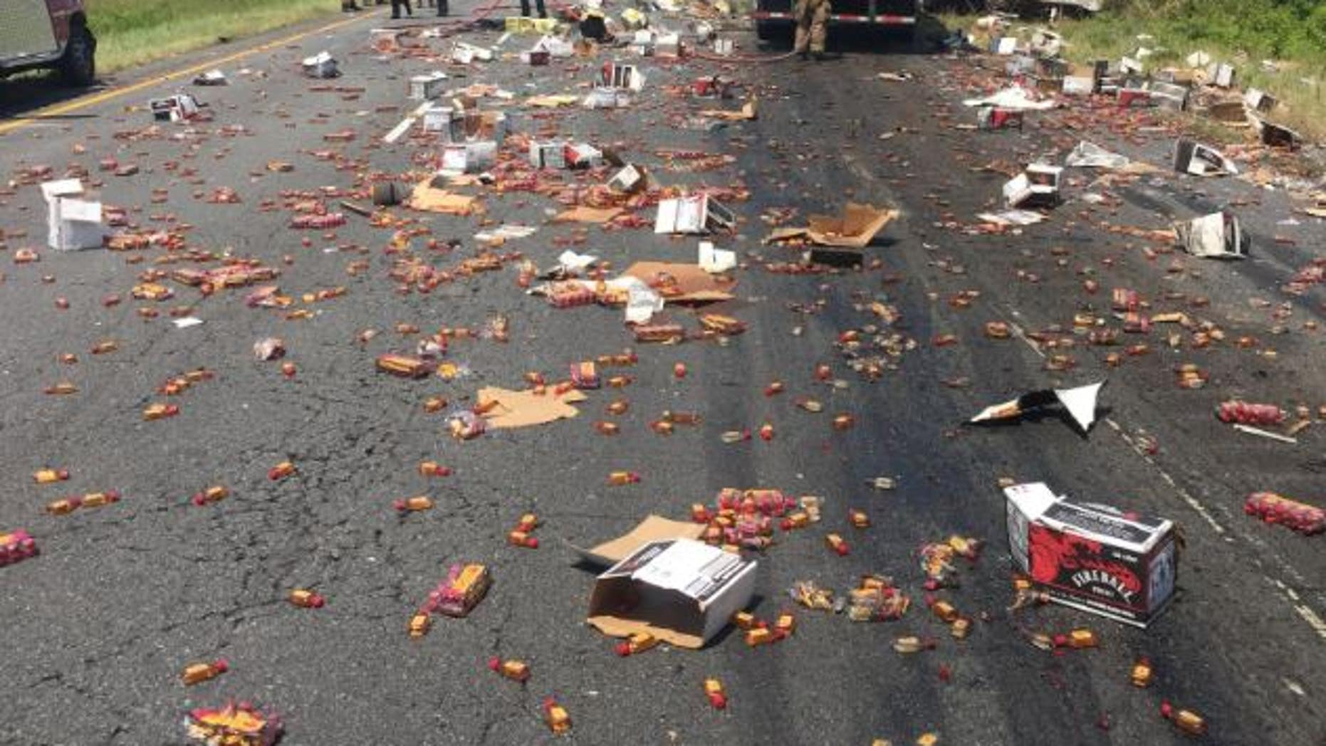Fireball bottles were splayed across a highway in Arkansas this week as part of a semi-truck crash, KATV reports.