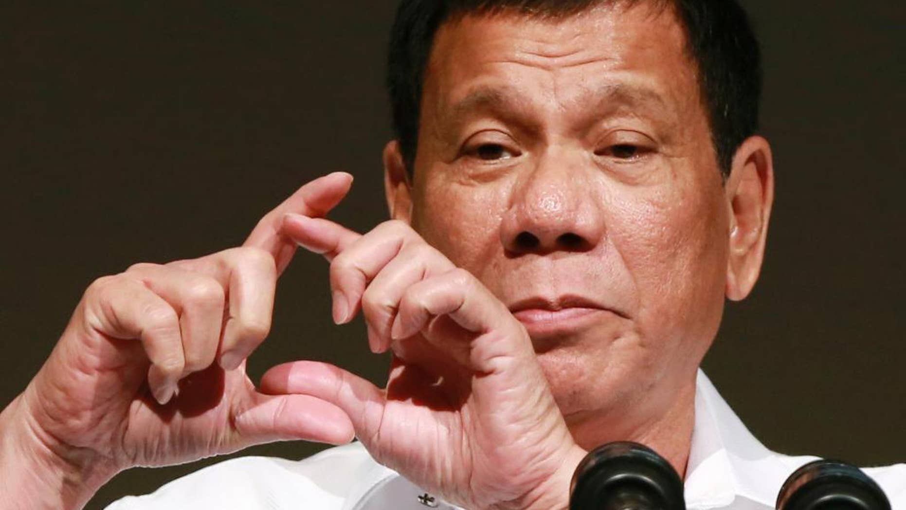 FILE - In this Oct. 26, 2016, file photo, Philippine President Rodrigo Duterte delivers a speech at the Philippine Economic Forum in Tokyo. Duterte, who has lashed out at U.S. President Barack Obama for criticizing his deadly crackdown on drugs, said his ties with the United States are likely to improve under Donald Trump, but that he is also excited to meet Russian leader Vladimir Putin at an upcoming Asia-Pacific summit. Duterte made upbeat remarks about both the president-elect and Putin at a news conference late Tuesday, Nov. 15, 2016 in Manila.  (AP Photo/Eugene Hoshiko, File)