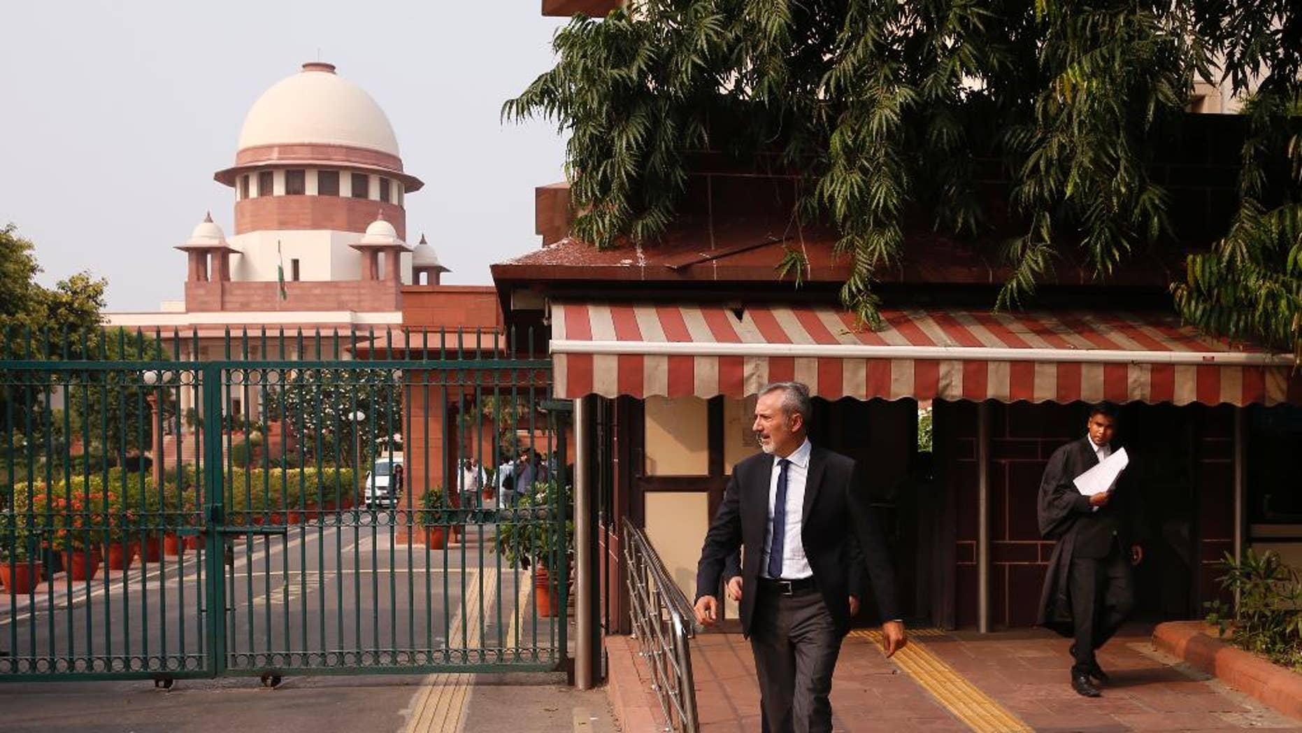 Italian ambassador to India Lorenzo Angeloni walks out of the Supreme Court in New Delhi, India, Tuesday, Sept. 20, 2016. The court was to decide on a plea to let Italian marine Massimiliano Latorre be allowed to remain in Italy till an international tribunal decides on the jurisdiction of the case. The court posted the matter for further hearing on Sept. 28. (AP Photo/Saurabh Das)