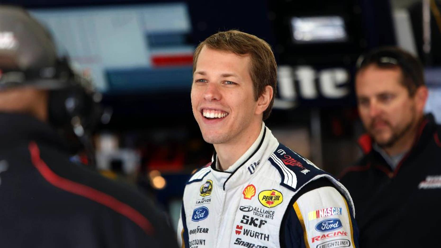 Driver Brad Keselowski talks with his crew during practice for Sunday's NASCAR Sprint Cup Series auto race at New Hampshire Motor Speedway Friday Sept. 19, 2014 in Loudon, N.H. (AP Photo/Jim Cole)
