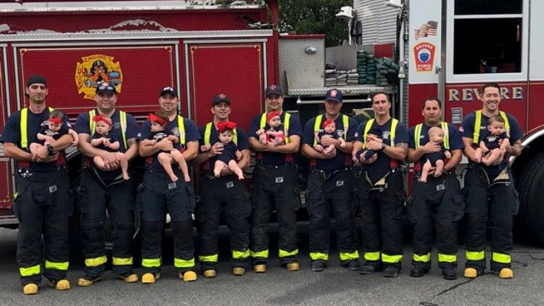 """These adorable pictures show a baby boom at a US firehouse - after NINE firefighters welcomed babies in the space of a year. See SWNS story NYBABIES: Rescuers at Revere Fire Department in Massachusetts posed with their bundles of joy for a heartwarming snap organised by the firemen's wives. The women, who call themselves the """"fire wives"""", took the pictures when they read about a fire department in Oklahoma which welcomed seven babies in 15 months. They realised that their firefighters had produced nine babies in one year - three boys and six girls - easily beating the Glenpool Fire Department."""