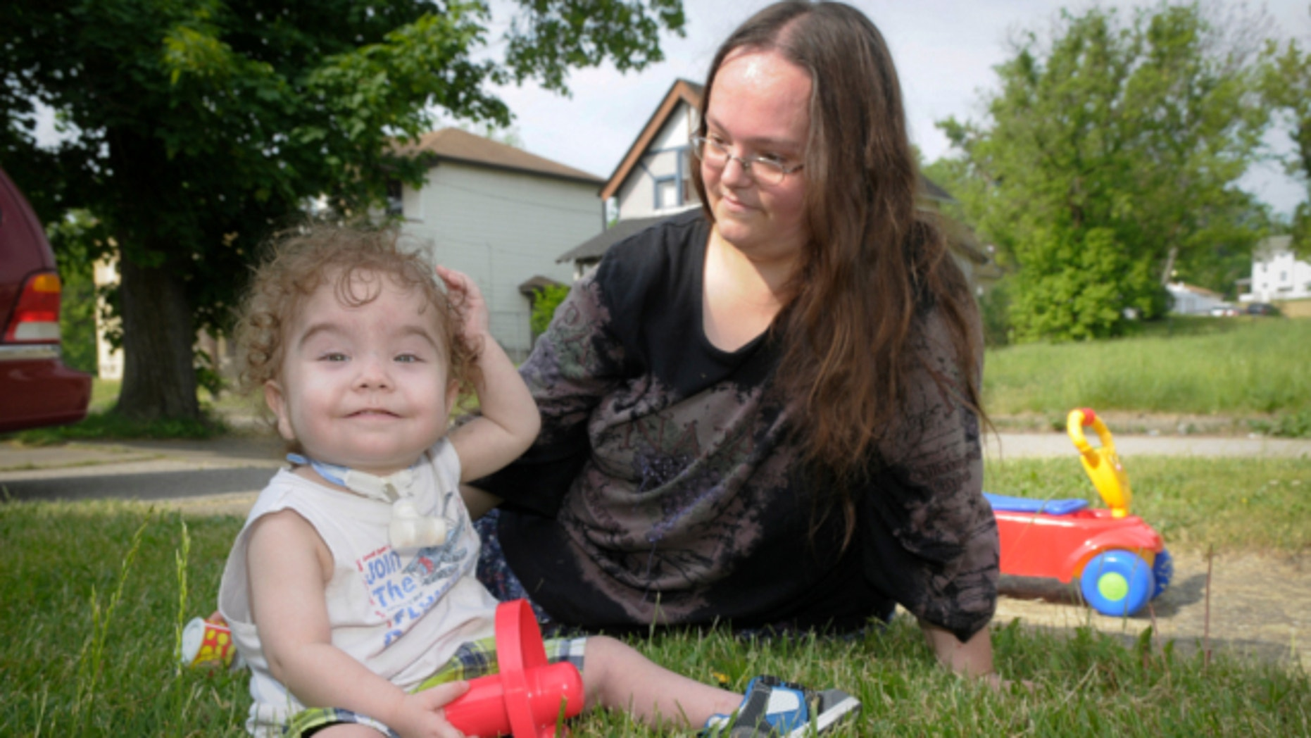 May 21, 2013: Kaiba Gionfriddo plays with his mother, April outside his Youngstown, Ohio home.