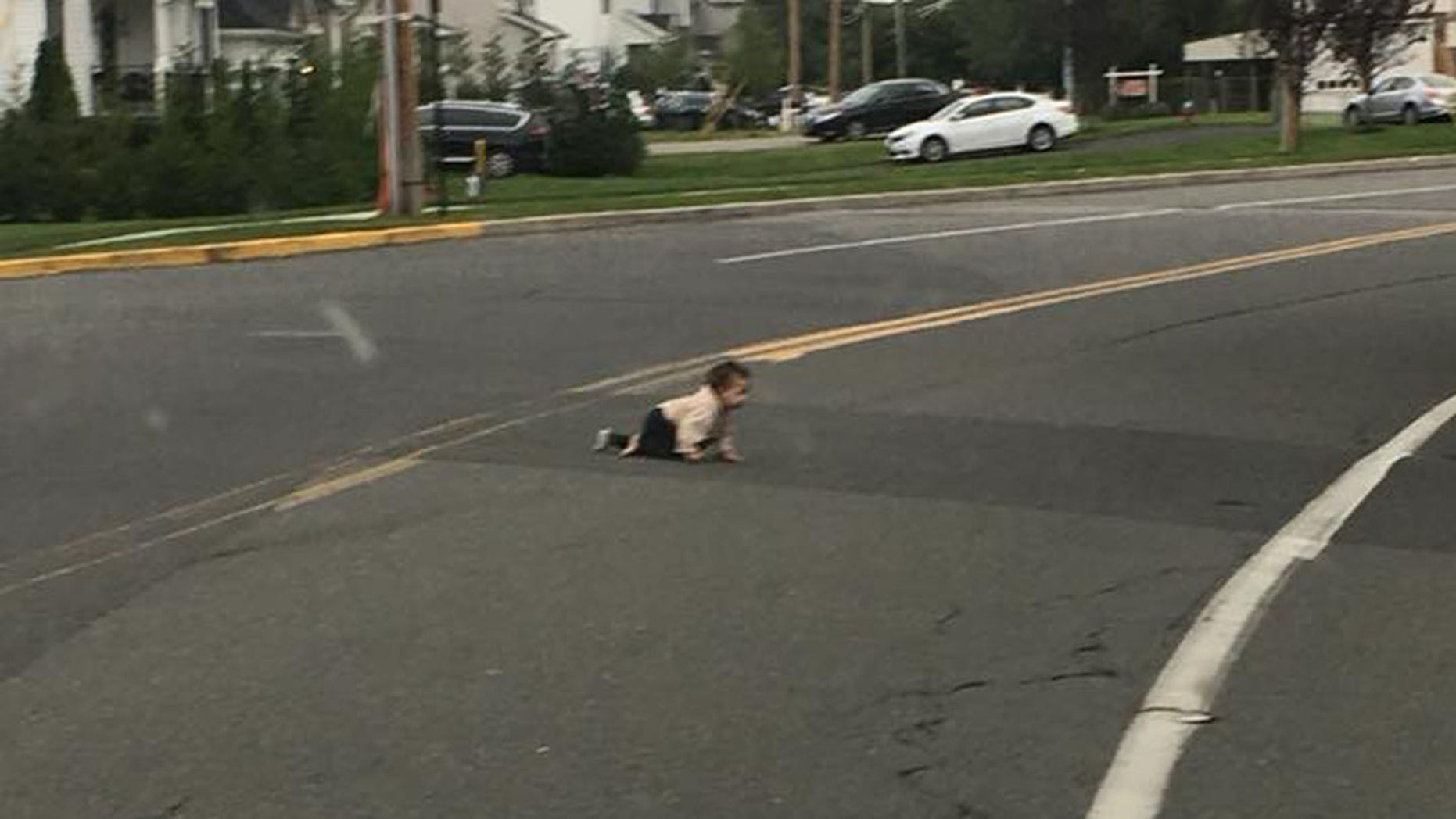 A baby girl was found crawling across a road in New Jersey on Saturday.