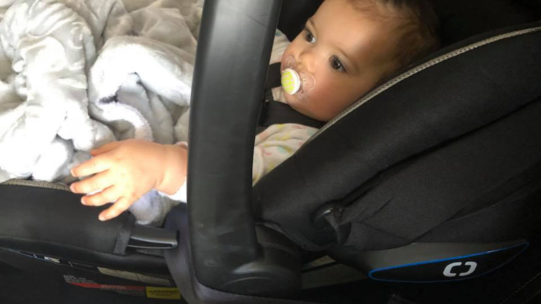 Cassie Hutchins claimed United Airlines crew on her flight home from Denver would not allow her small daughter to sit rear-facing in her car seat.