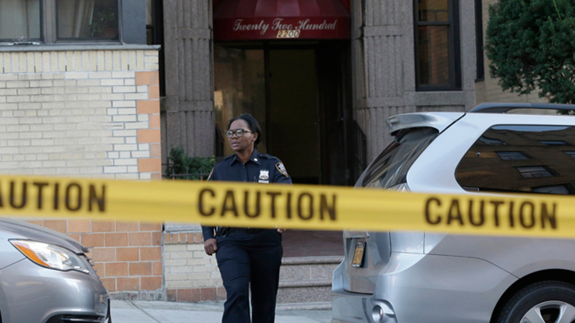 Oct. 15, 2015: A police officer leaves an apartment building in the Bronx borough of New York.