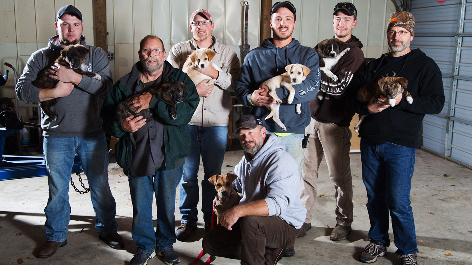 Oct. 26, 2016: This photo shows, from left, Jake Rowe holding Knox, Joe Gruber holding Bear, Alex Manchester holding Rosie, Doug Craddock with Annie, Mitchel Craddock holding Brimmie, Brent Witters holding Finn and Dexter Jennings holding Gunner pose for a photo in Vicksburg, Mich.