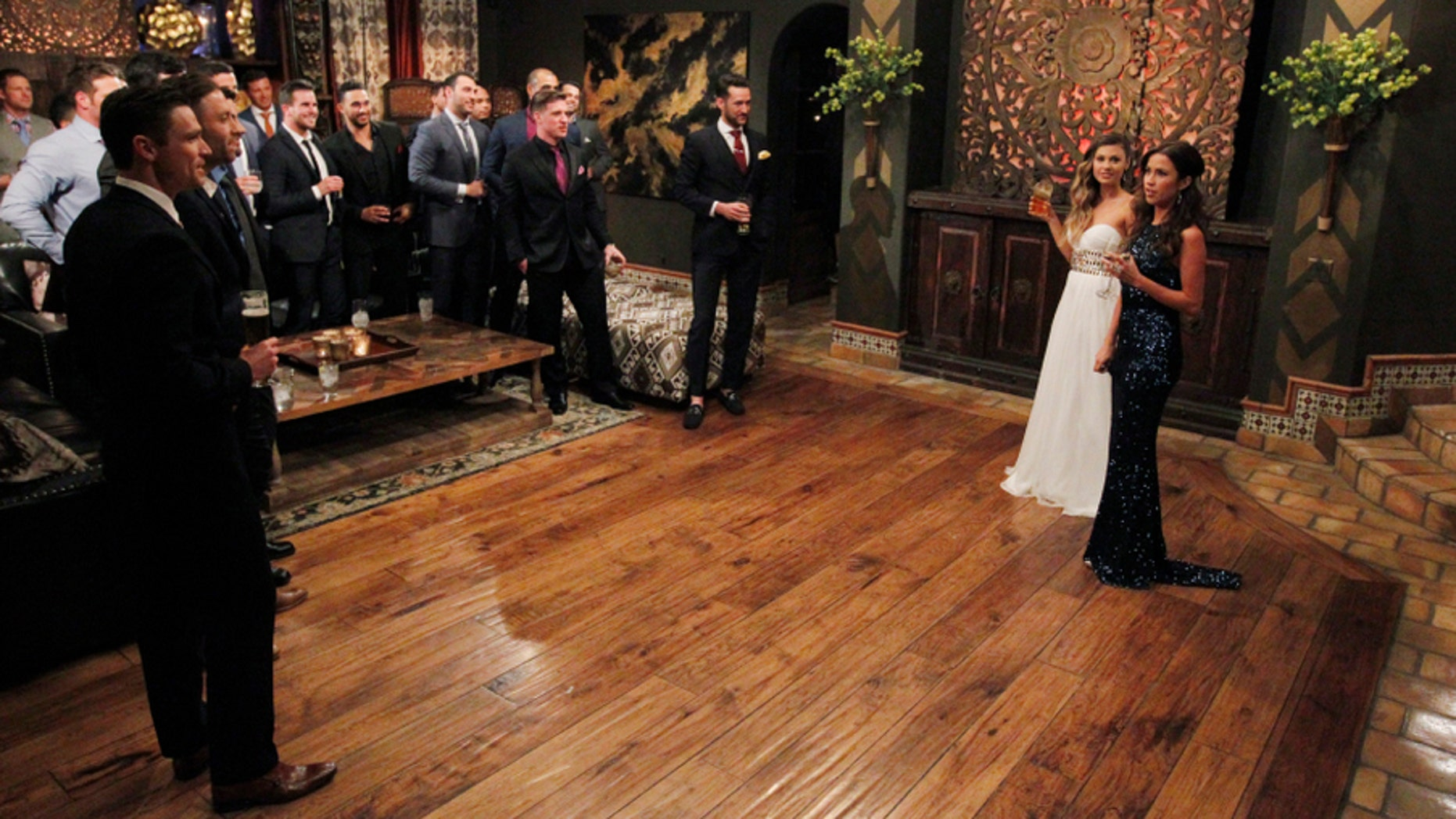 "The entire cast of ""The Bachelorette"" is shown during the rose ceremony."