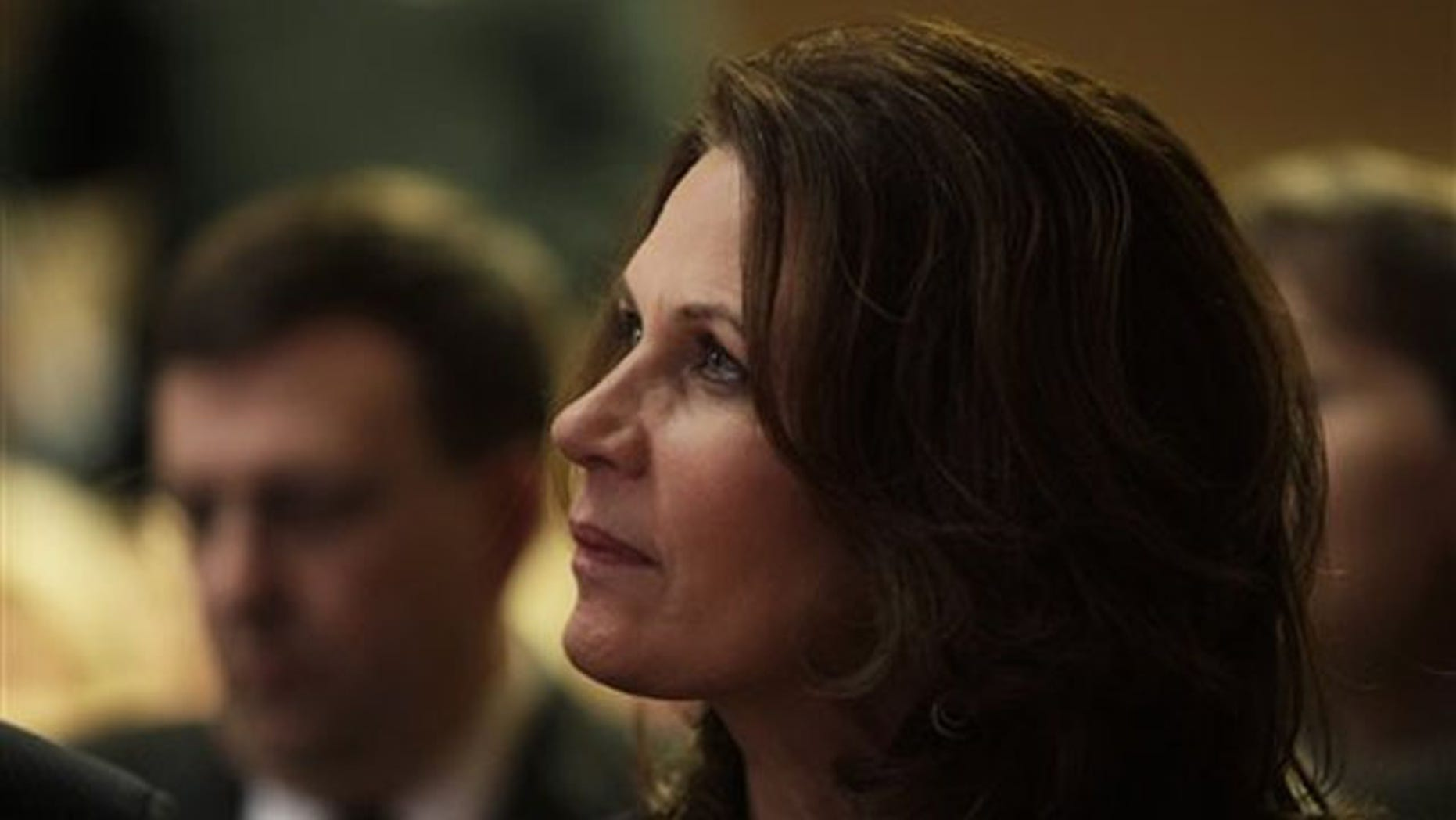 Rep. Michele Bachmann waits to speak at a reception by the Iowans for Tax Relief Jan. 21 in Des Moines.