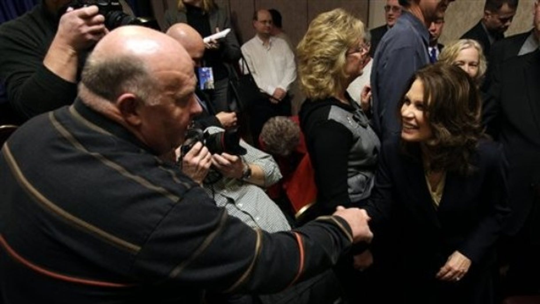 In this Jan. 21, 2011 file photo, U.S. Rep. Michele Bachmann, R-Minn. , greets Jim Ervin, of Urbandale, Iowa, left, after speaking at a reception by the Iowans for Tax Relief in Des Moines, Iowa. (AP)