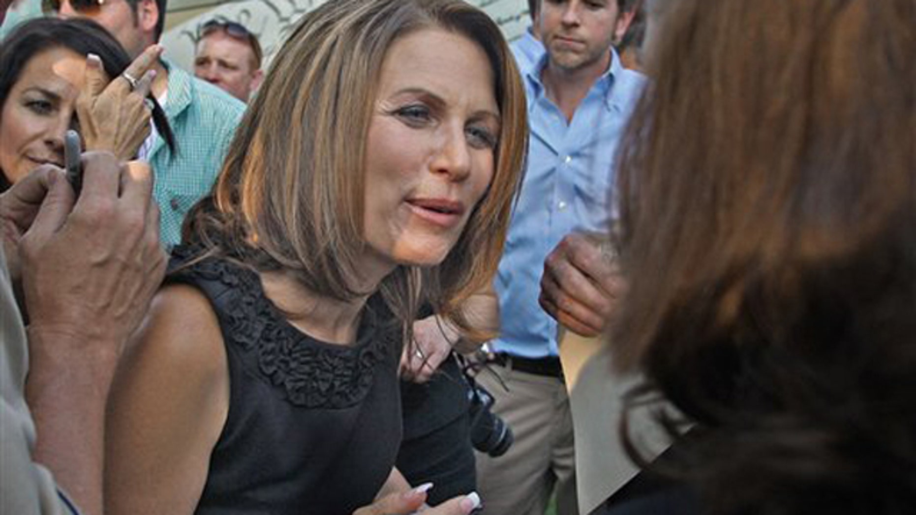 Rep. Michele Bachmann signs autographs during her appearance at a Tea Party Express rally Aug. 31 in Des Moines, Iowa.