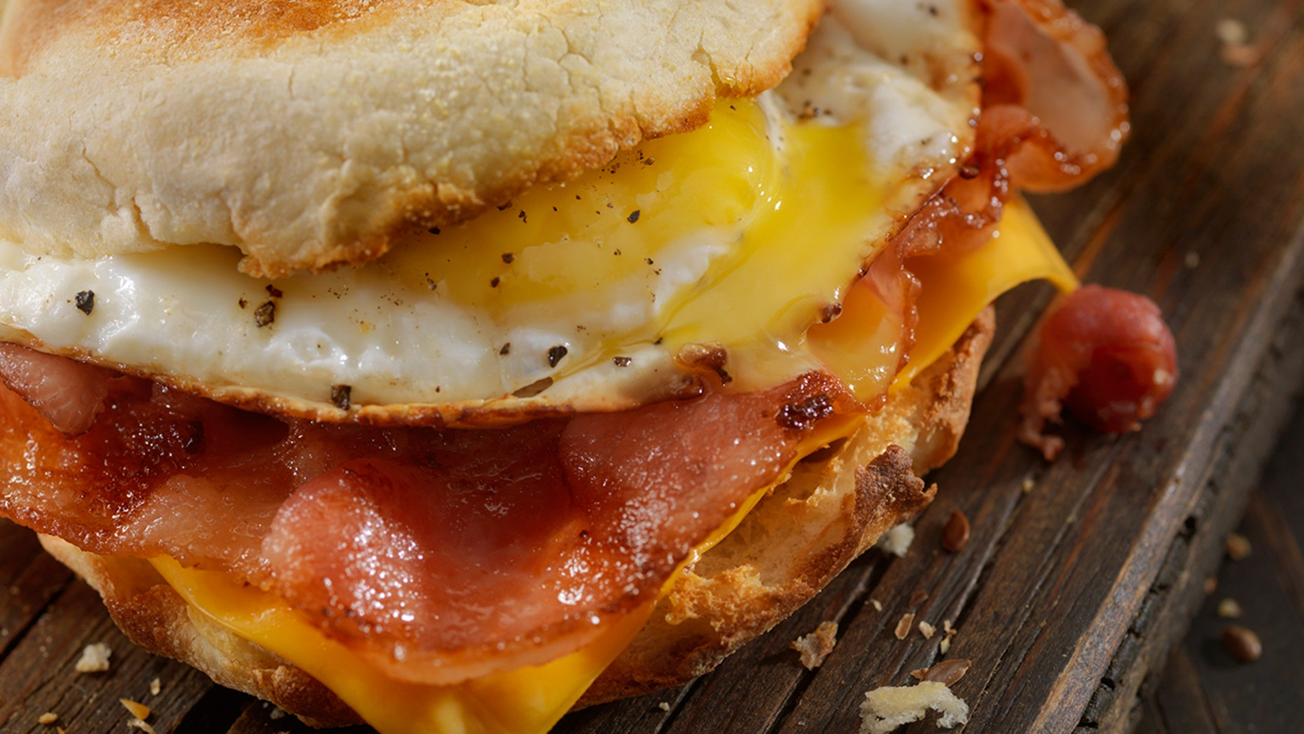 A plane passenger got into an argument with crew members when he found out he couldn't get a bacon sandwich.