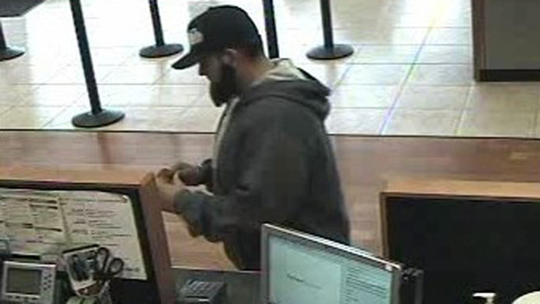 "An undated photo of a California bank robber, whom the FBI has dubbed the ""Bad beard bandit,"" at a bank in Manteca, Calif."