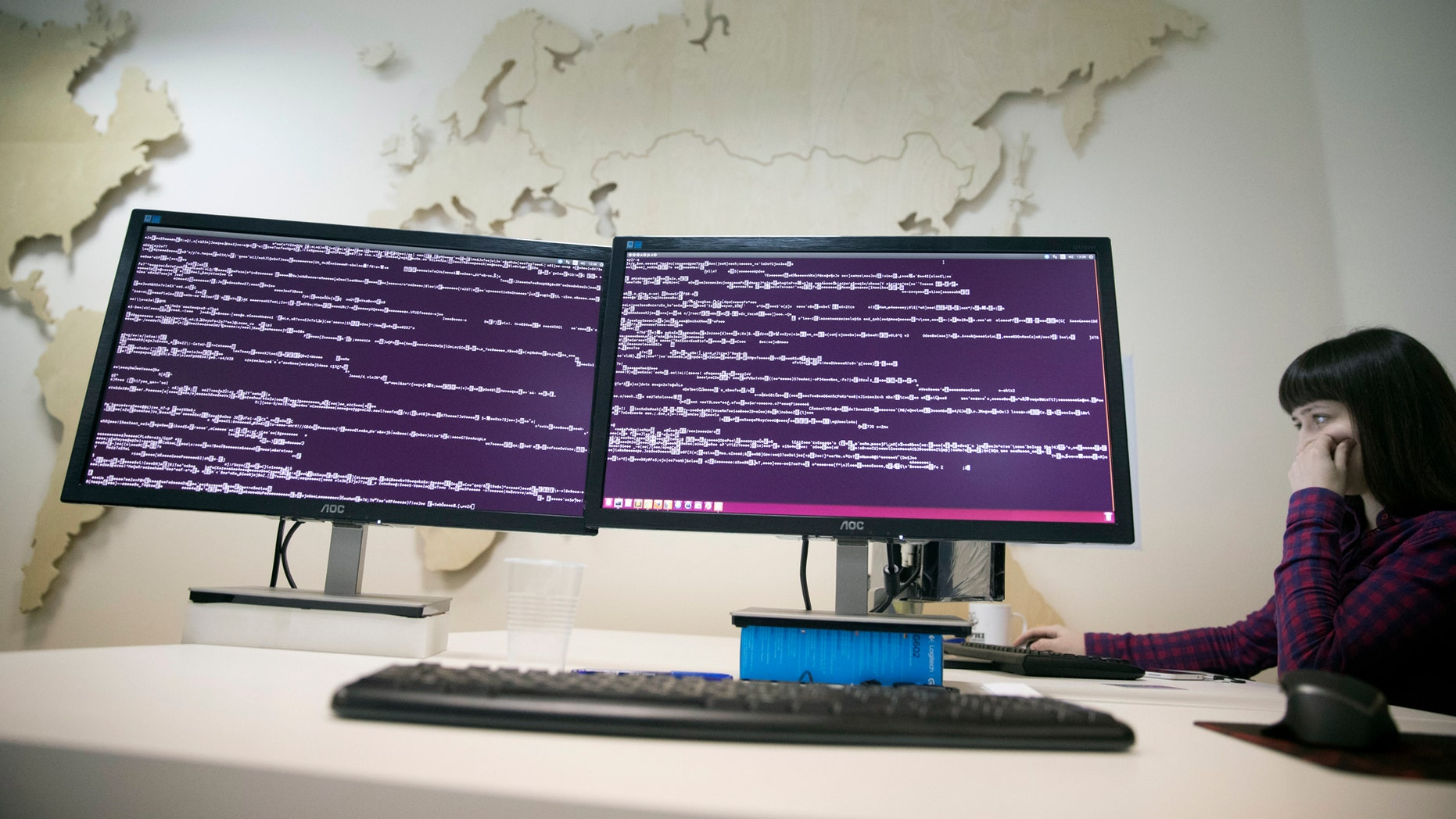 A computer code is seen on displays in the office of Global Cyber Security Company Group-IB in Moscow, Russia, Wednesday, Oct. 25, 2017 as reports emerge of new ransomware dubbed 'Bad Rabbit.'  (AP Photo/Pavel Golovkin)